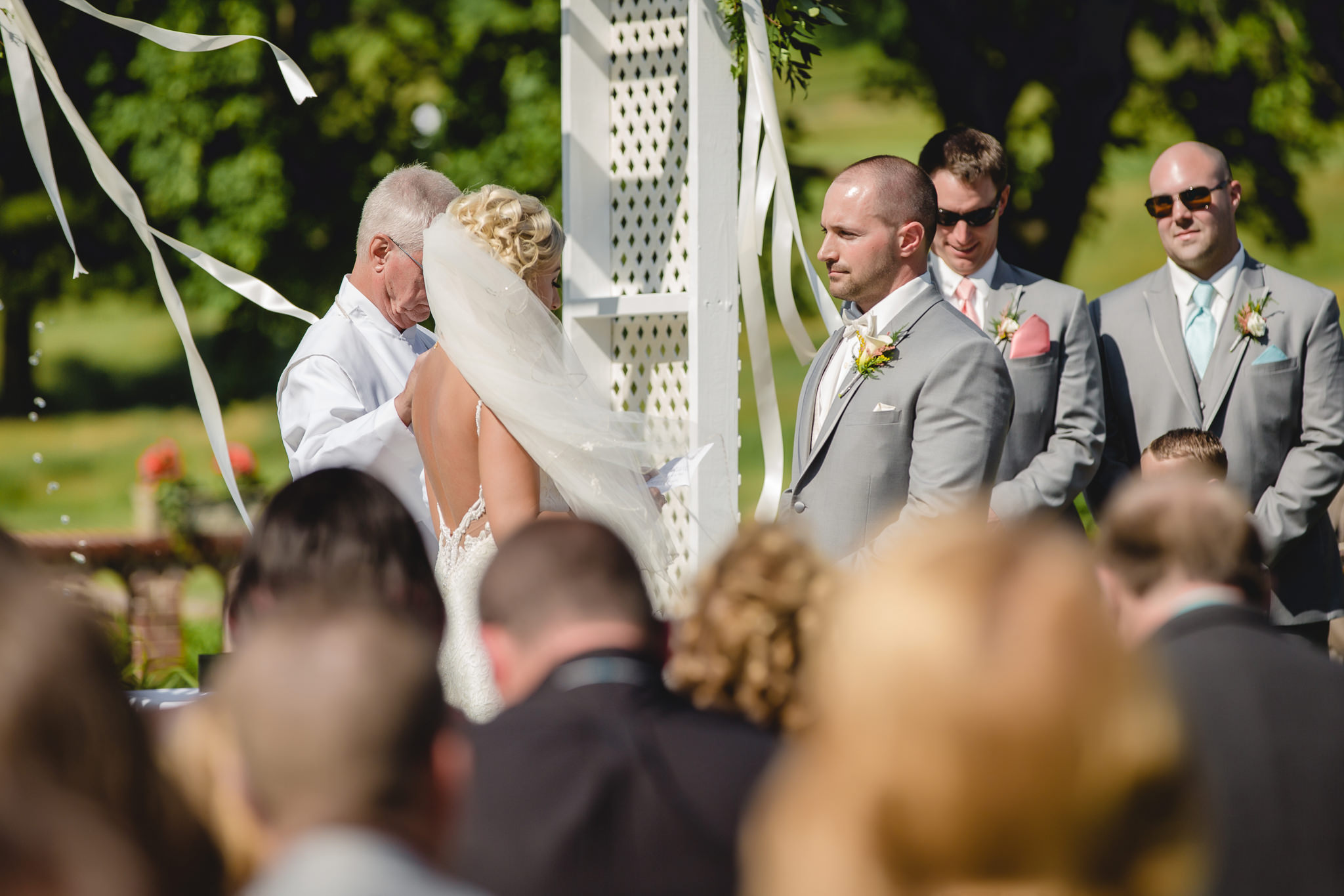 Groom says his vows at an outdoor ceremony at Linden Hall