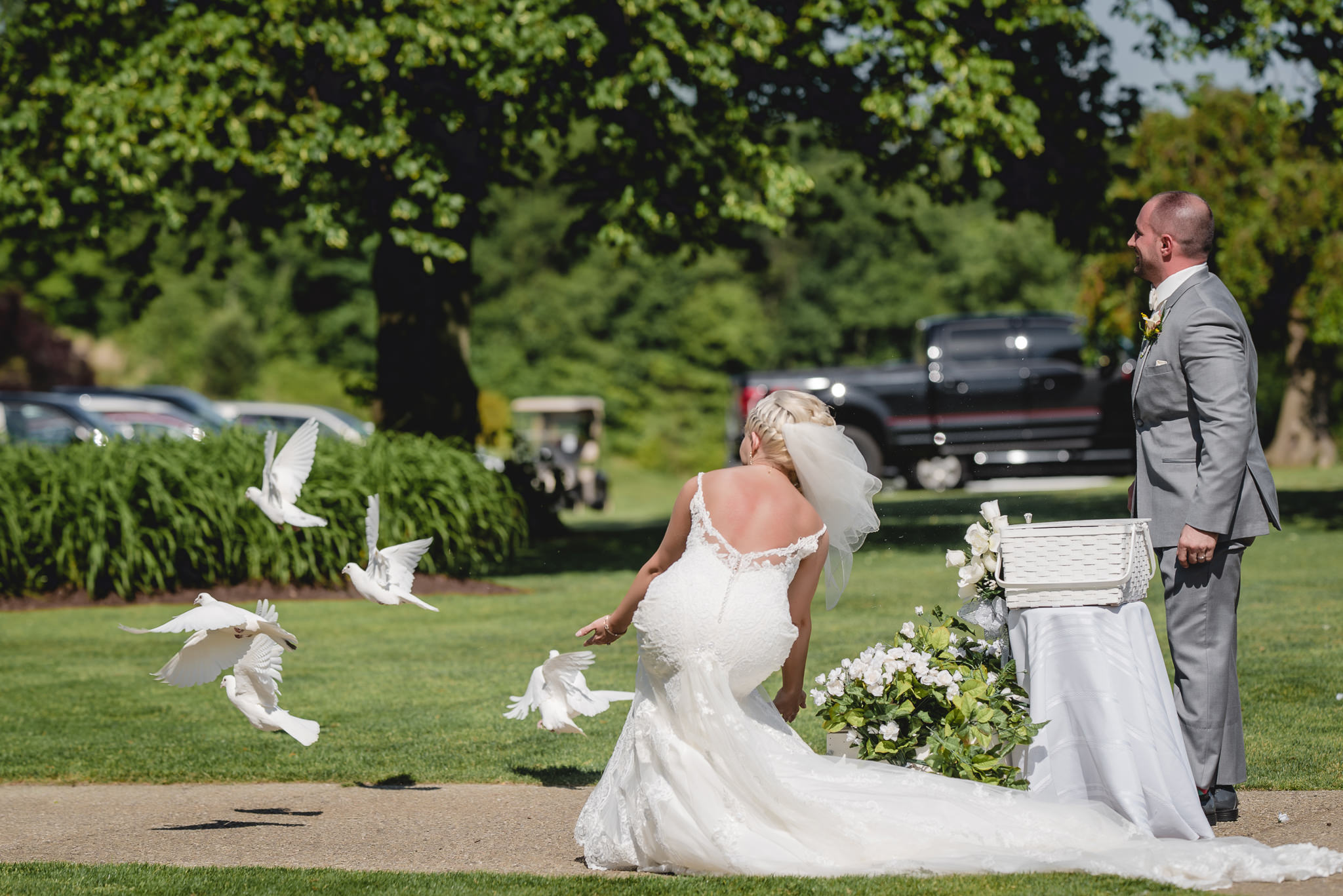 Bride and groom release white doves at the wedding ceremony