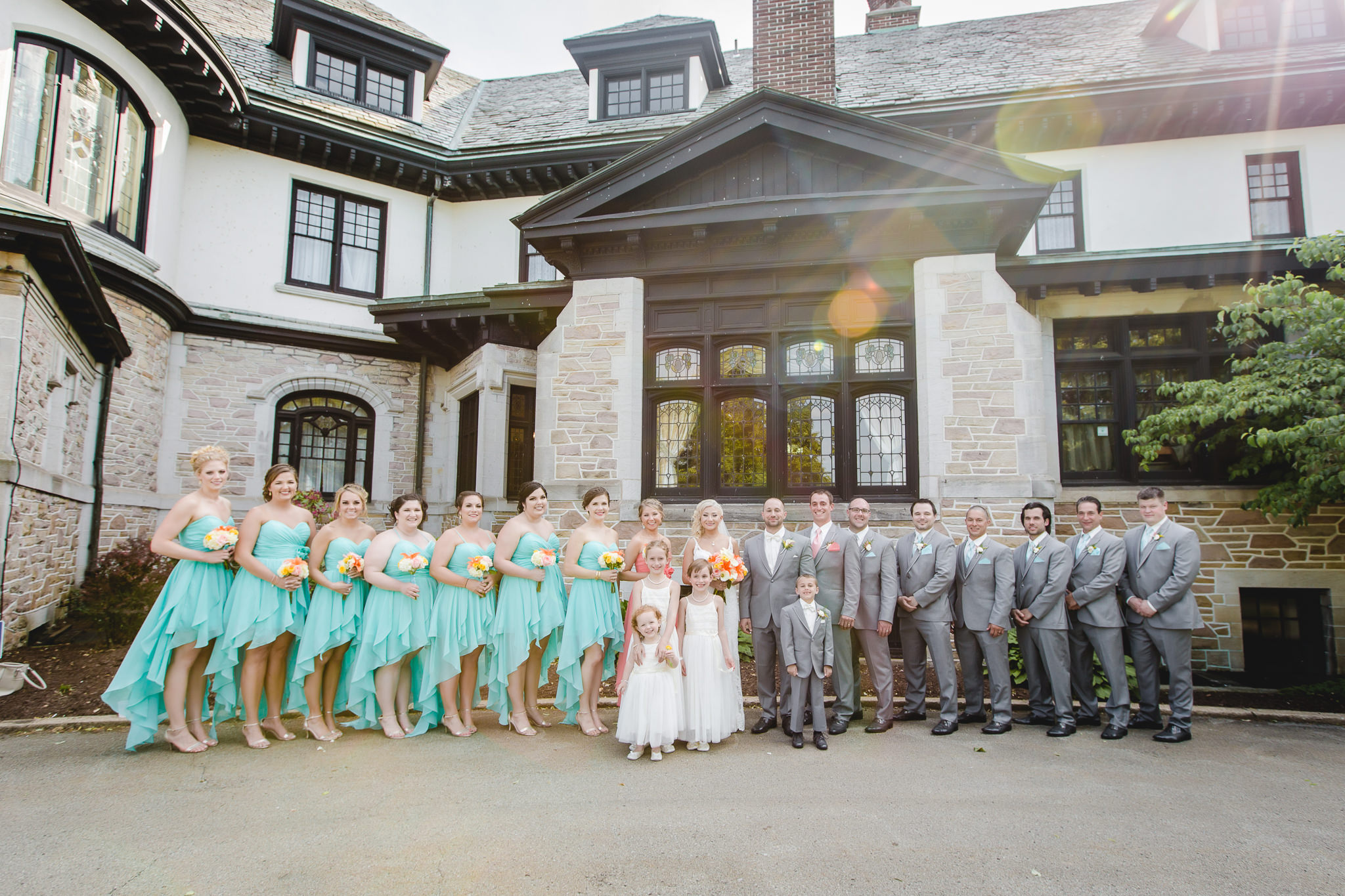 Bridal party poses for a photo outside of Linden Hall mansion