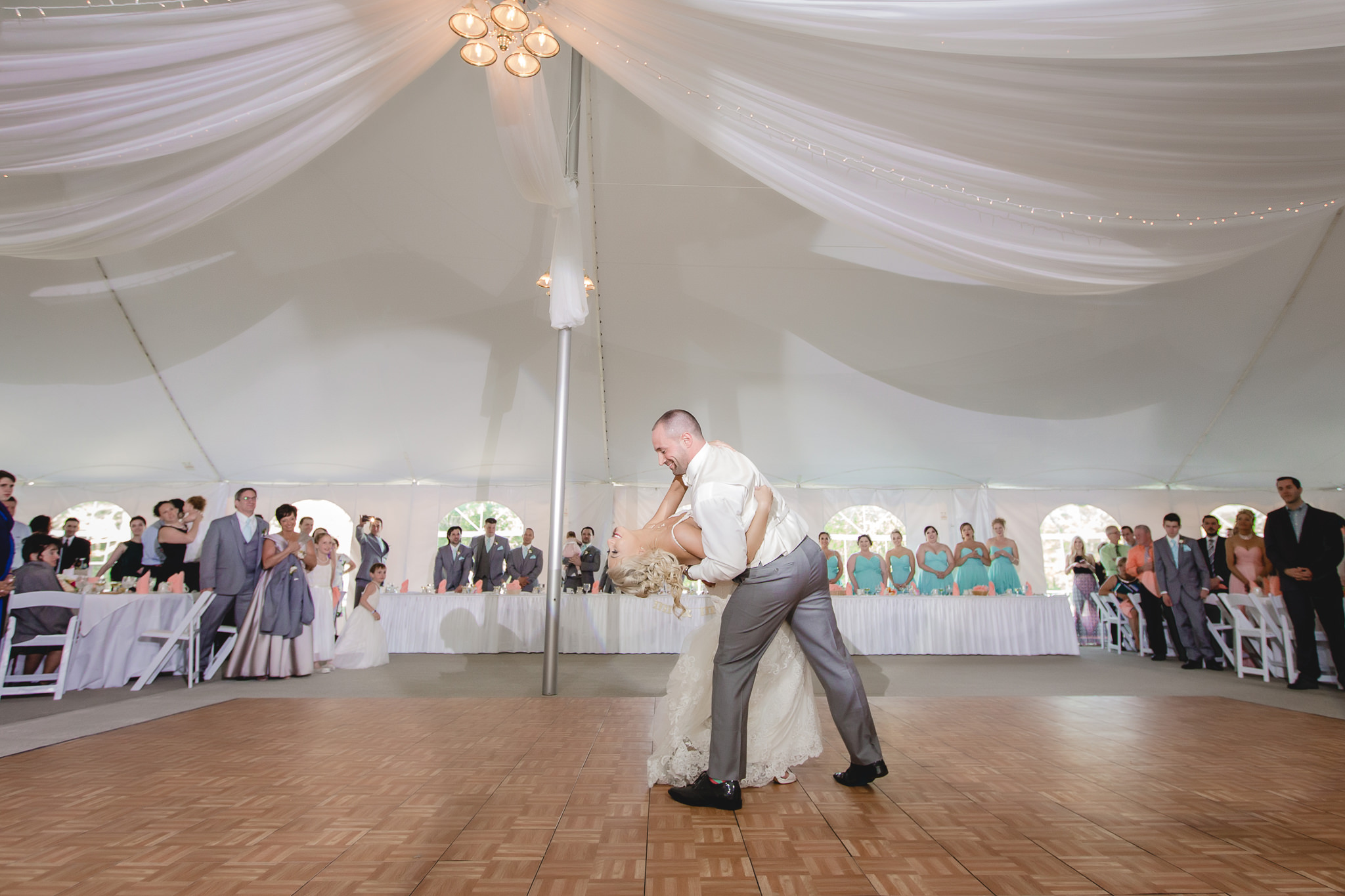 Groom dips his bride during the first dance