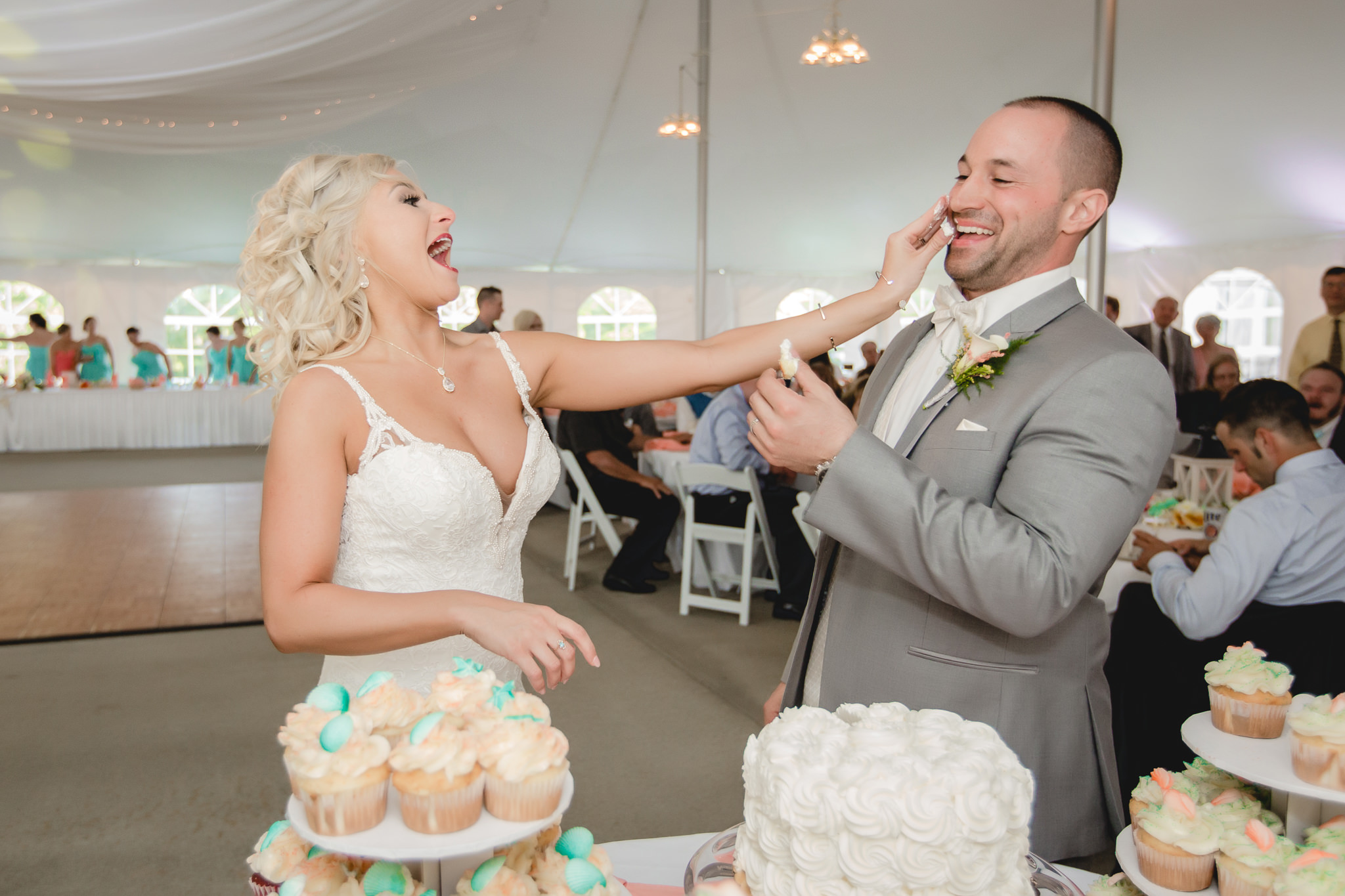 Bride smashes some icing into the groom's face