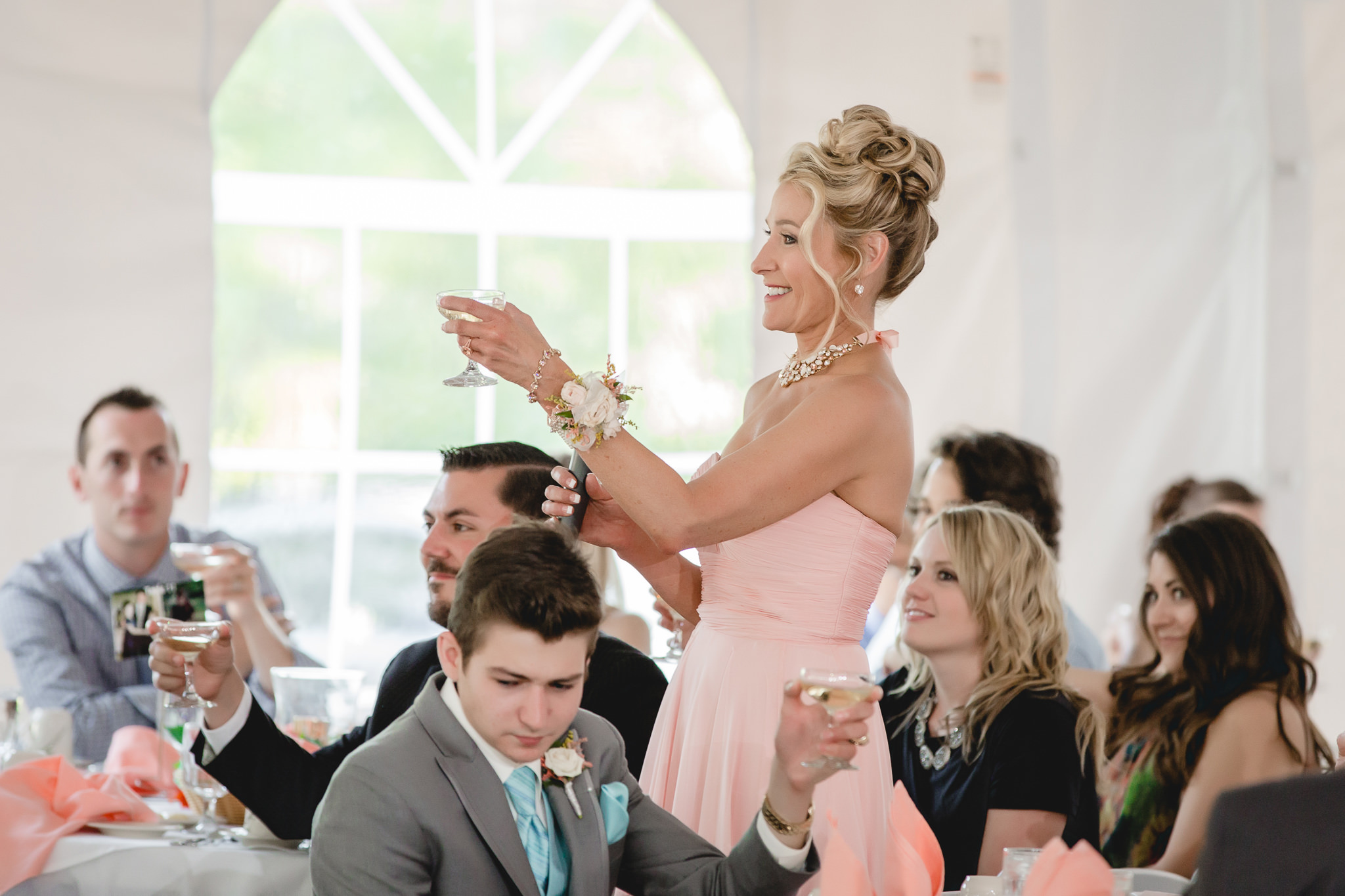 Mother of the bride toasts the newlyweds
