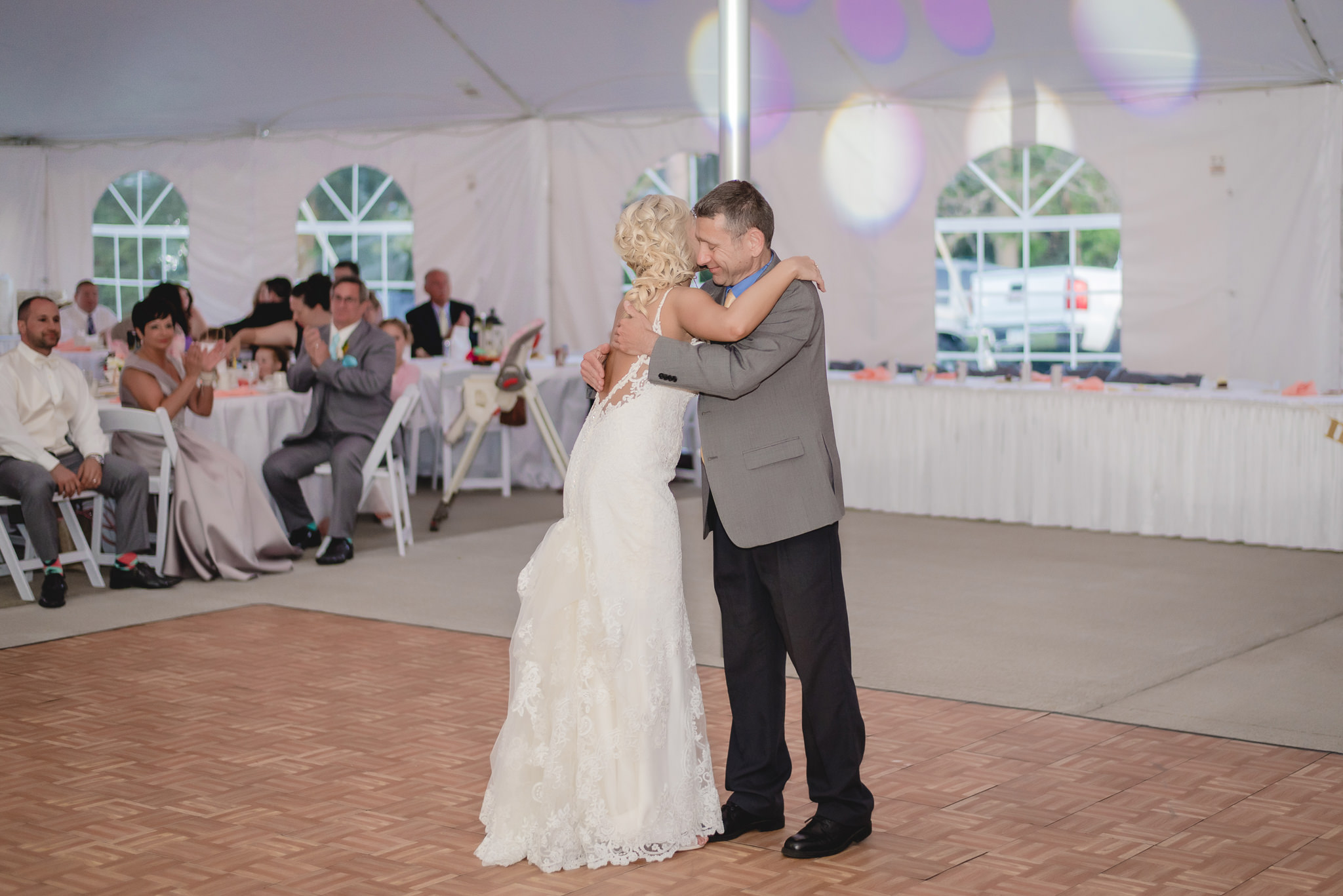 Bride hugs her uncle during father daughter dance