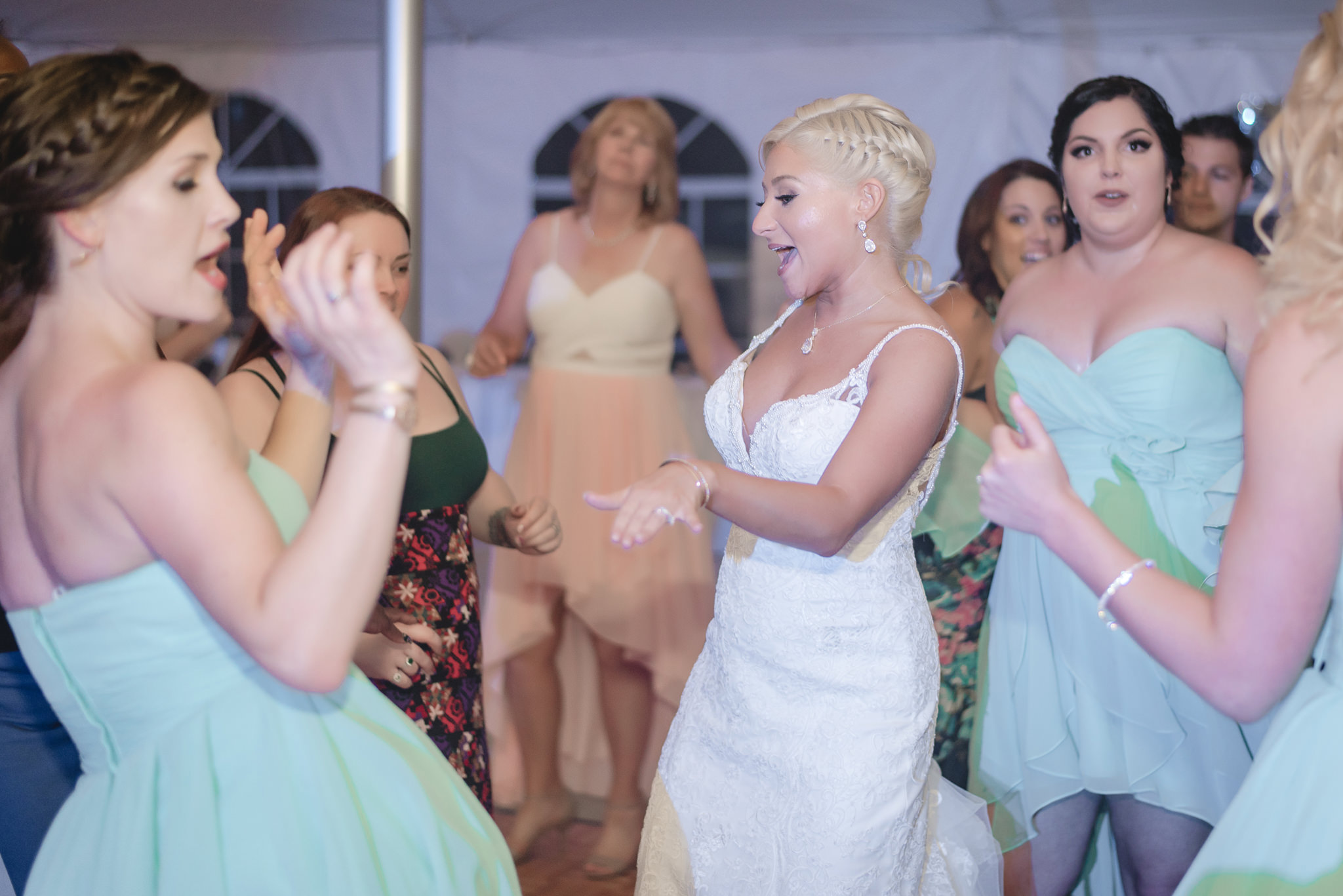 Bride dances to the music at her reception