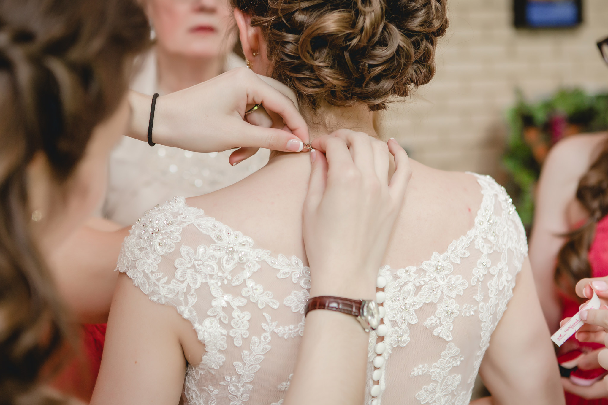 Maid of honor puts necklace on bride before her Shannopin Country Club wedding