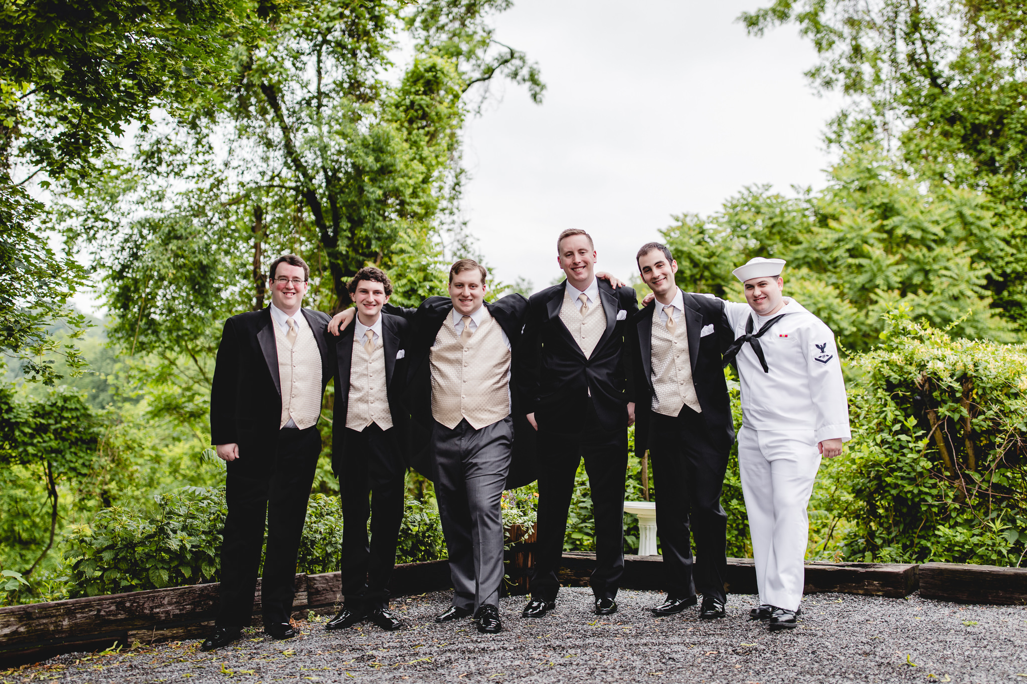 Groomsmen posing in their tuxes from Men's Wearhouse