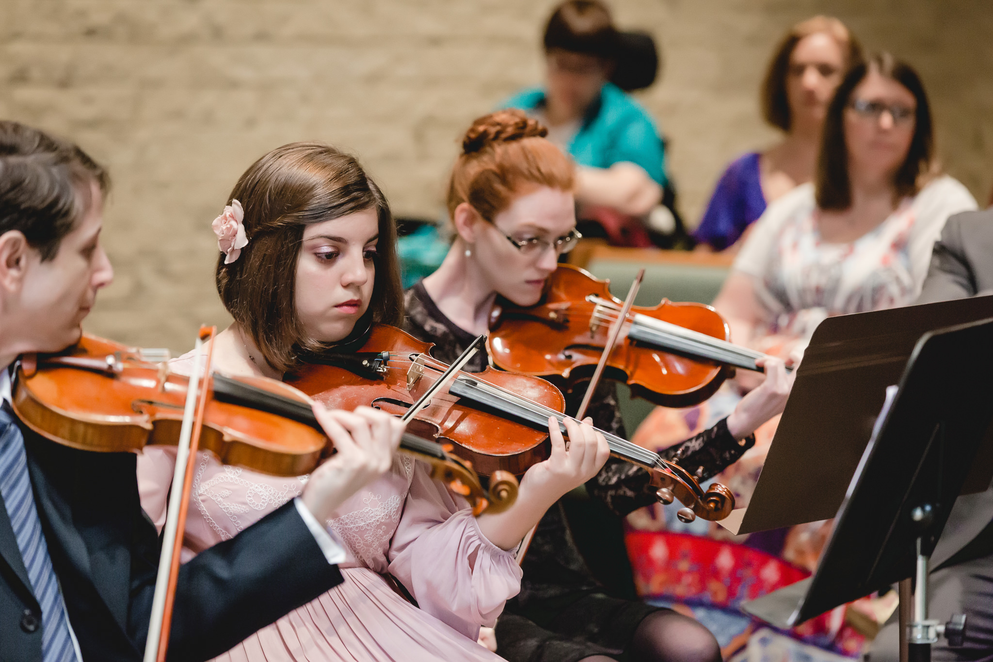Groom's sister playing violin during wedding ceremony at St. John Neumann Church in Pittsburgh PA
