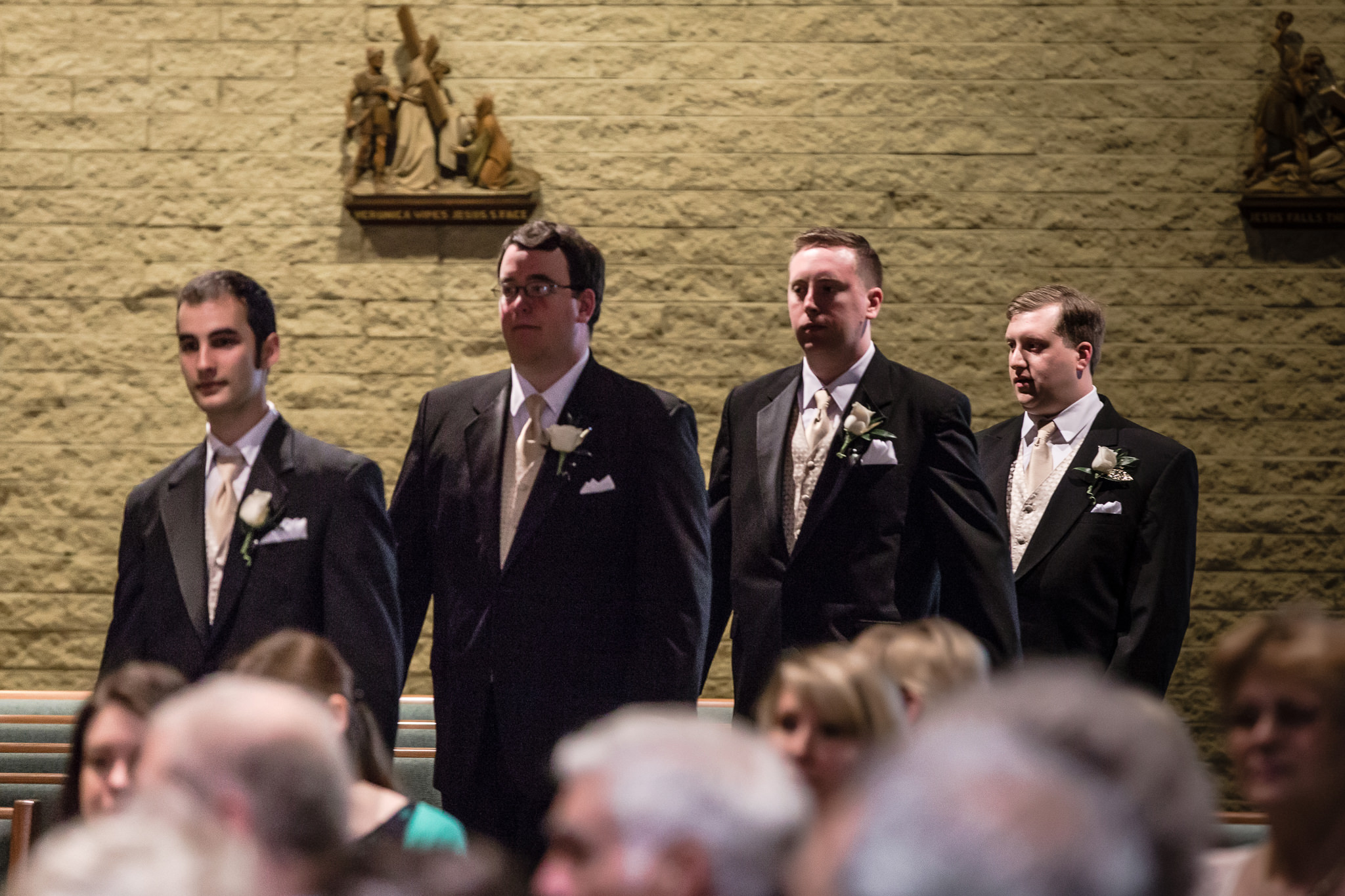 Groom & groomsmen approach altar for wedding ceremony at St. John Neumann Church in Pittsburgh PA