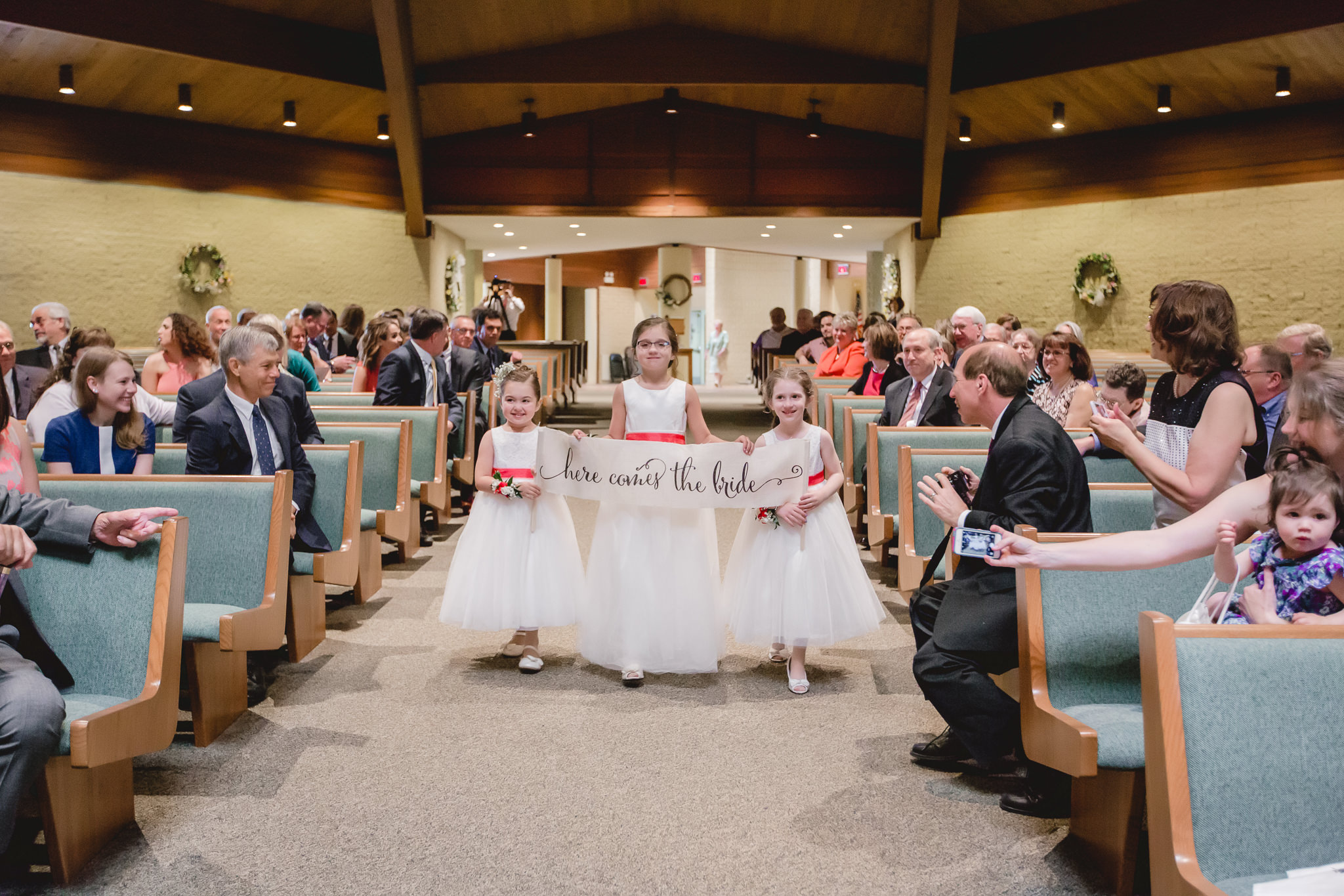 Flower girls during ceremony at St. John Neumann Church in Pittsburgh PA