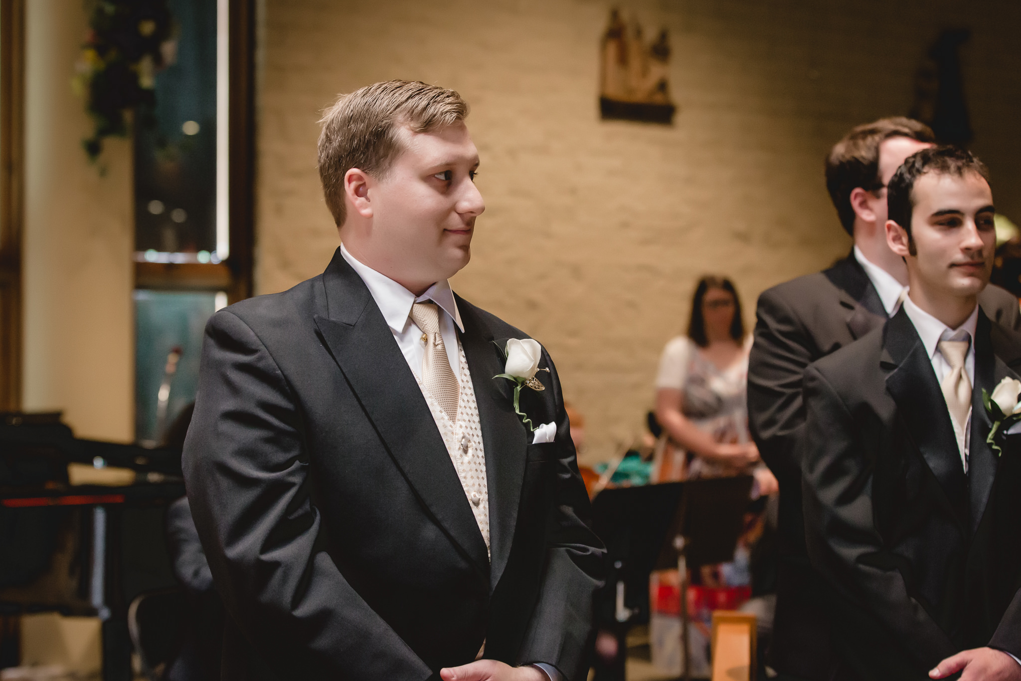 Groom waiting for his bride during wedding ceremony at St. John Neumann Church in Pittsburgh PA