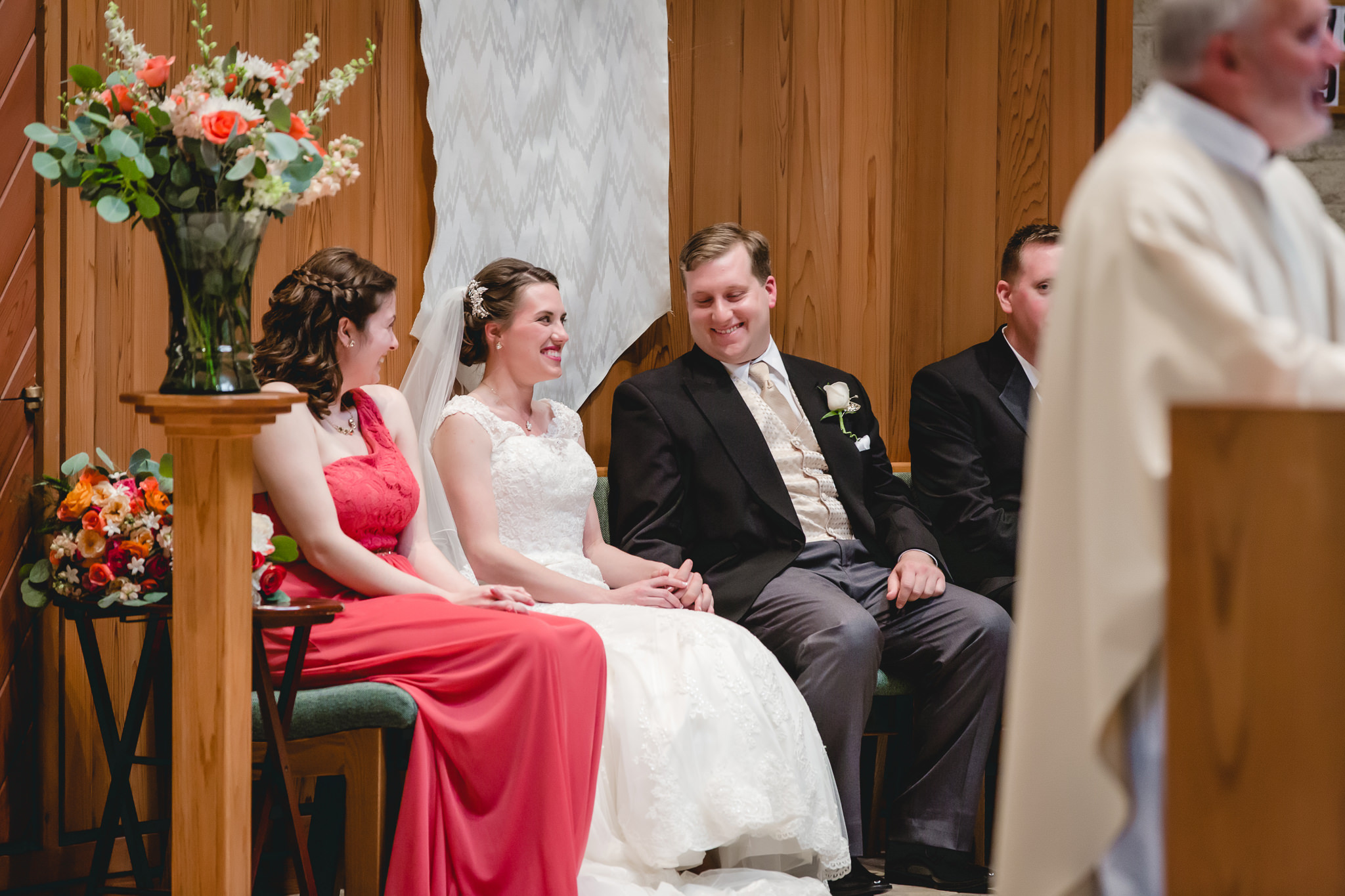 Bride & groom laughing during wedding ceremony at St. John Neumann Church in Pittsburgh PA
