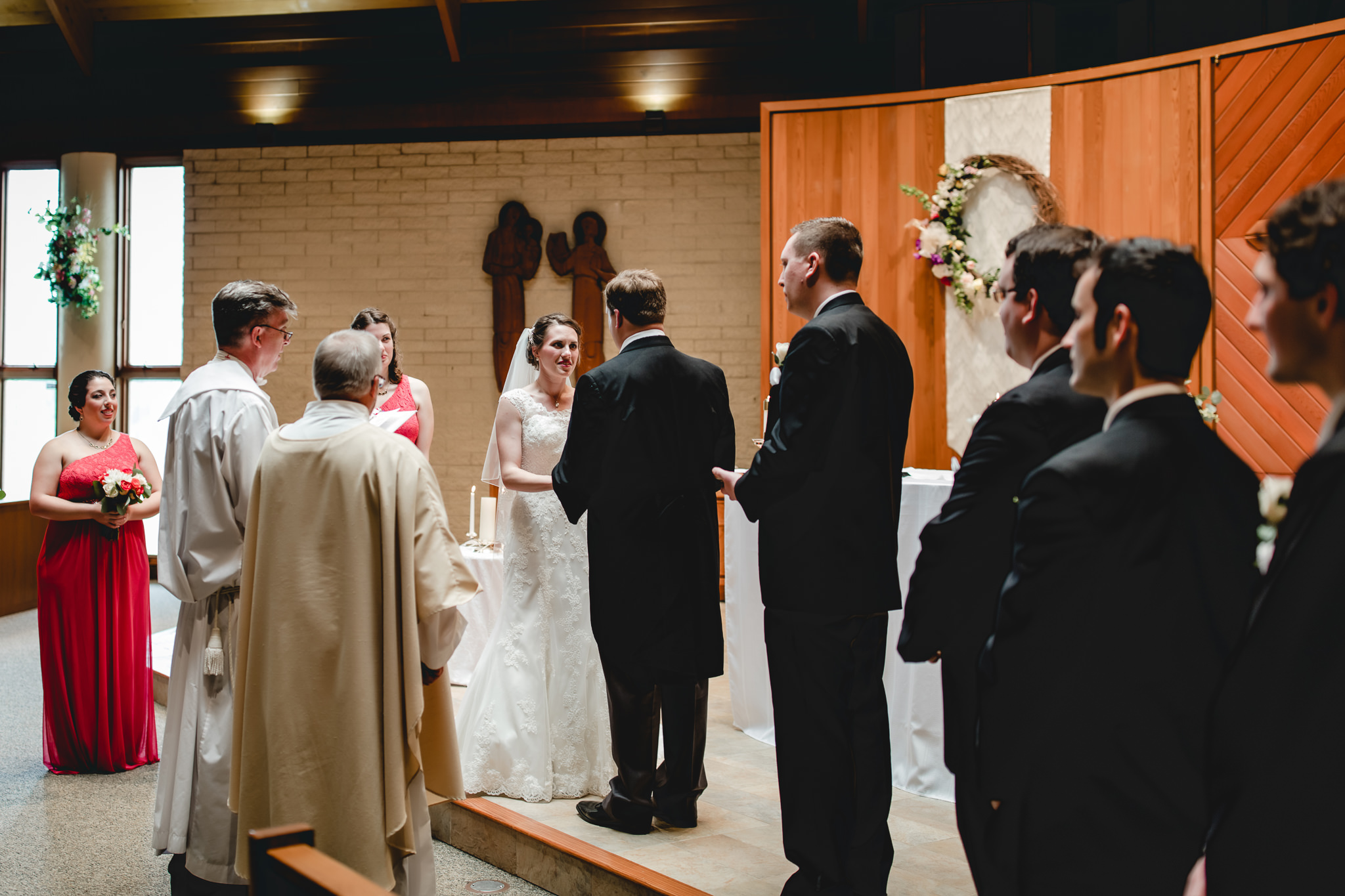 Bride says her vows during ceremony at St. John Neumann Church in Pittsburgh PA