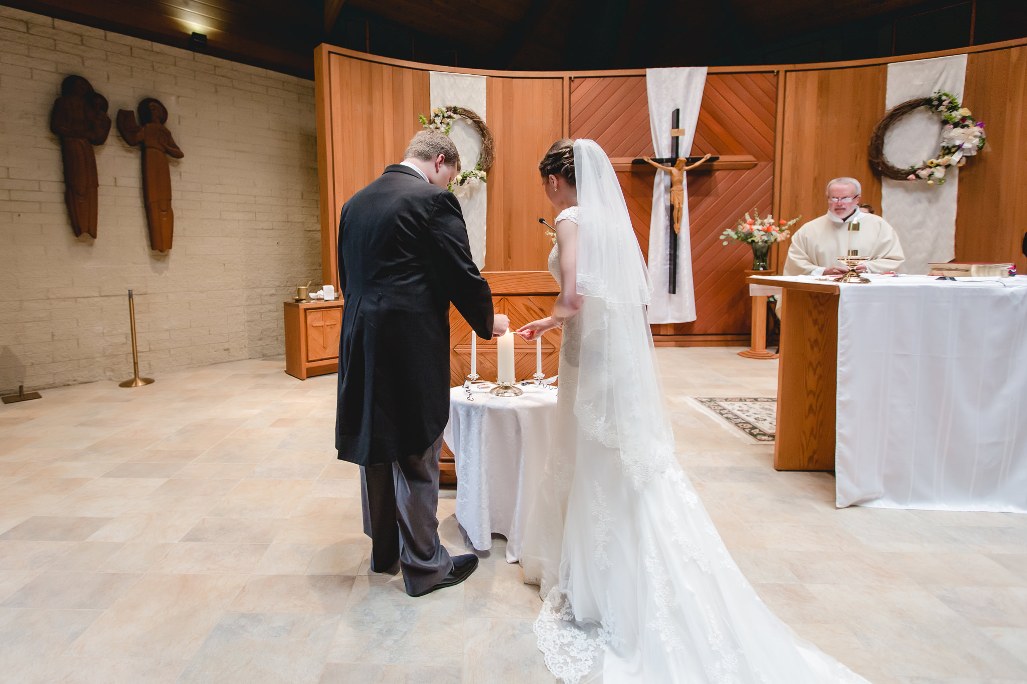 Bride & groom light the unity candle at St. John Neumann Church in Pittsburgh PA