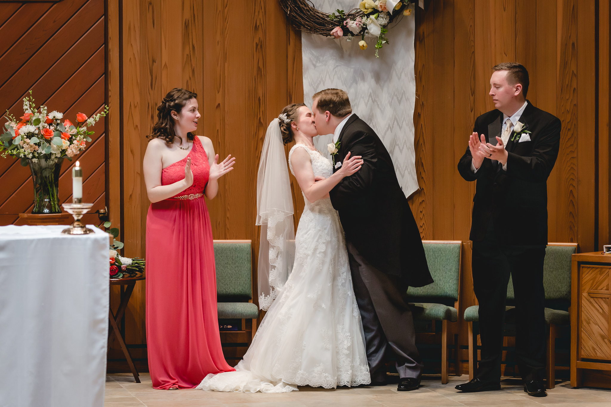 Bride & groom's first kiss at St. John Neumann Church in Pittsburgh PA wedding ceremony