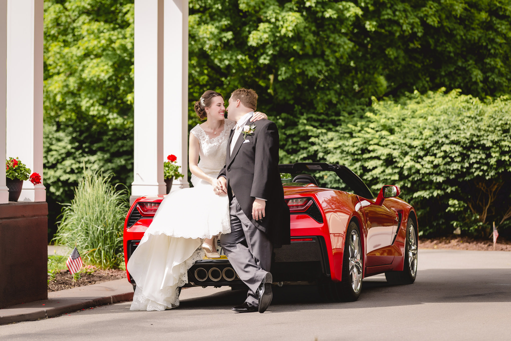 Bride & groom on red Corvette at Shannopin Country Club wedding