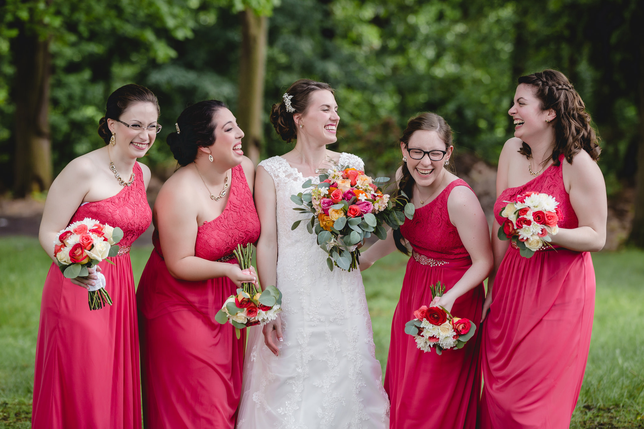Bridesmaids laughing with bride at Shannopin Country Club
