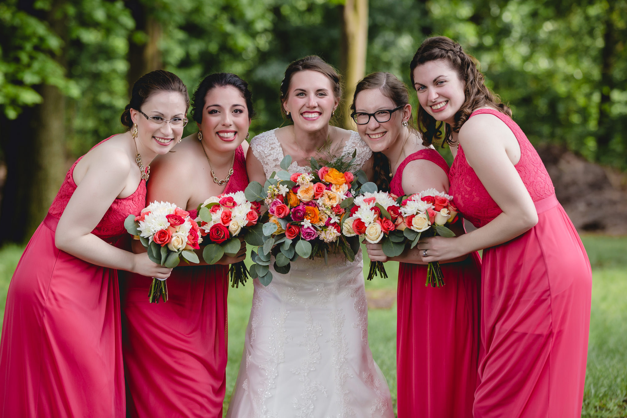 Bridesmaids posing with bouquets at Shannopin Country Club