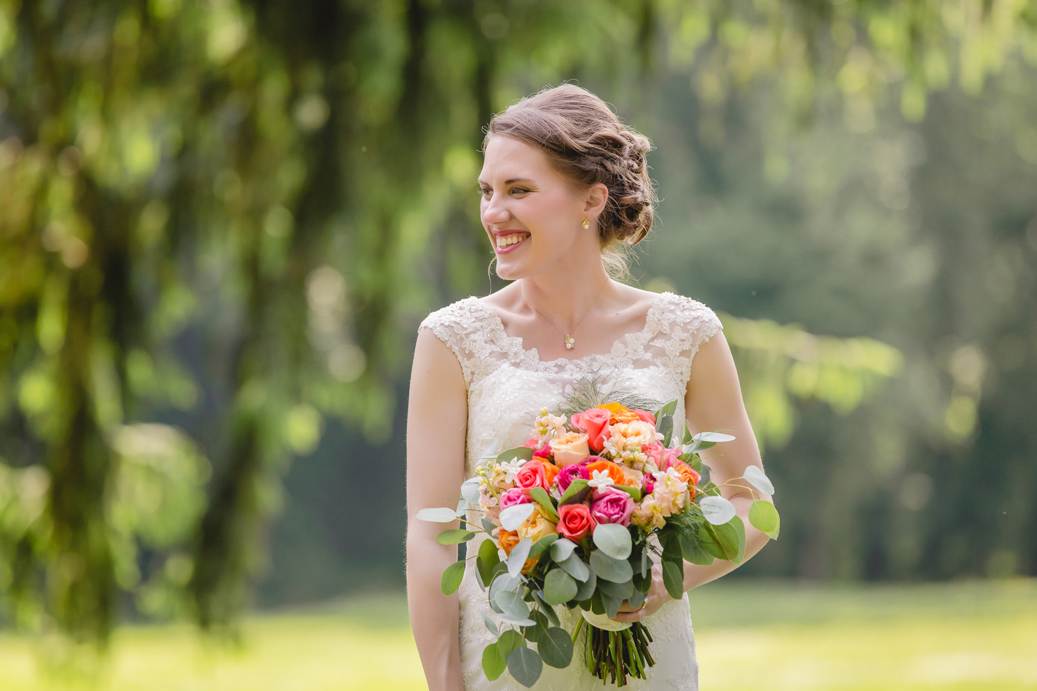Bride holding bouquet by McCandless Floral at Shannopin Country Club