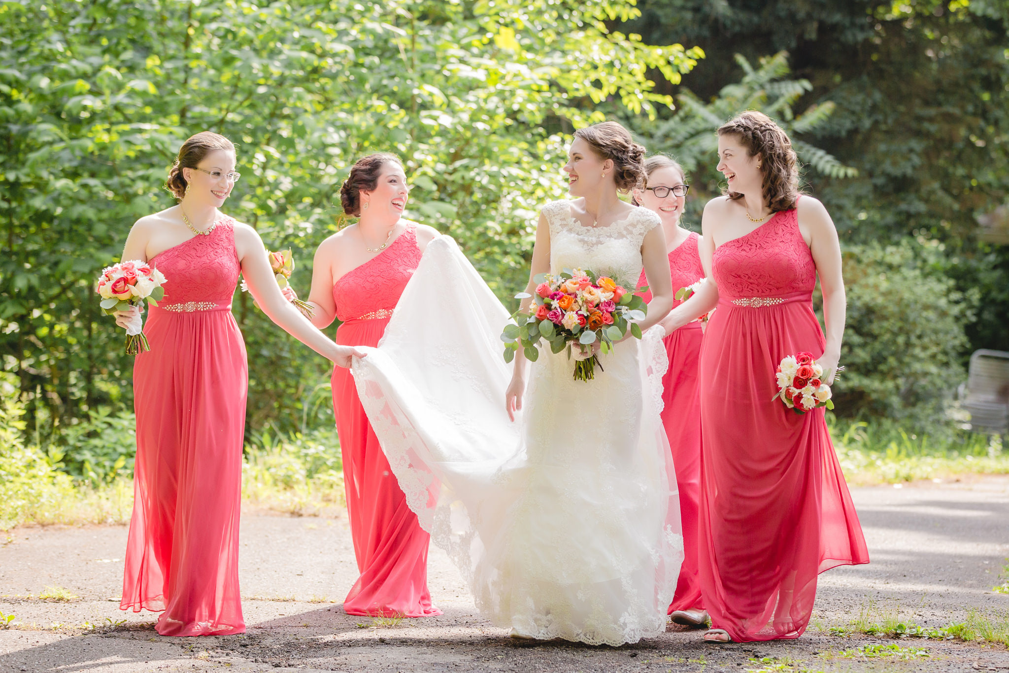 Bridesmaids walking with bride at Shannopin Country Club