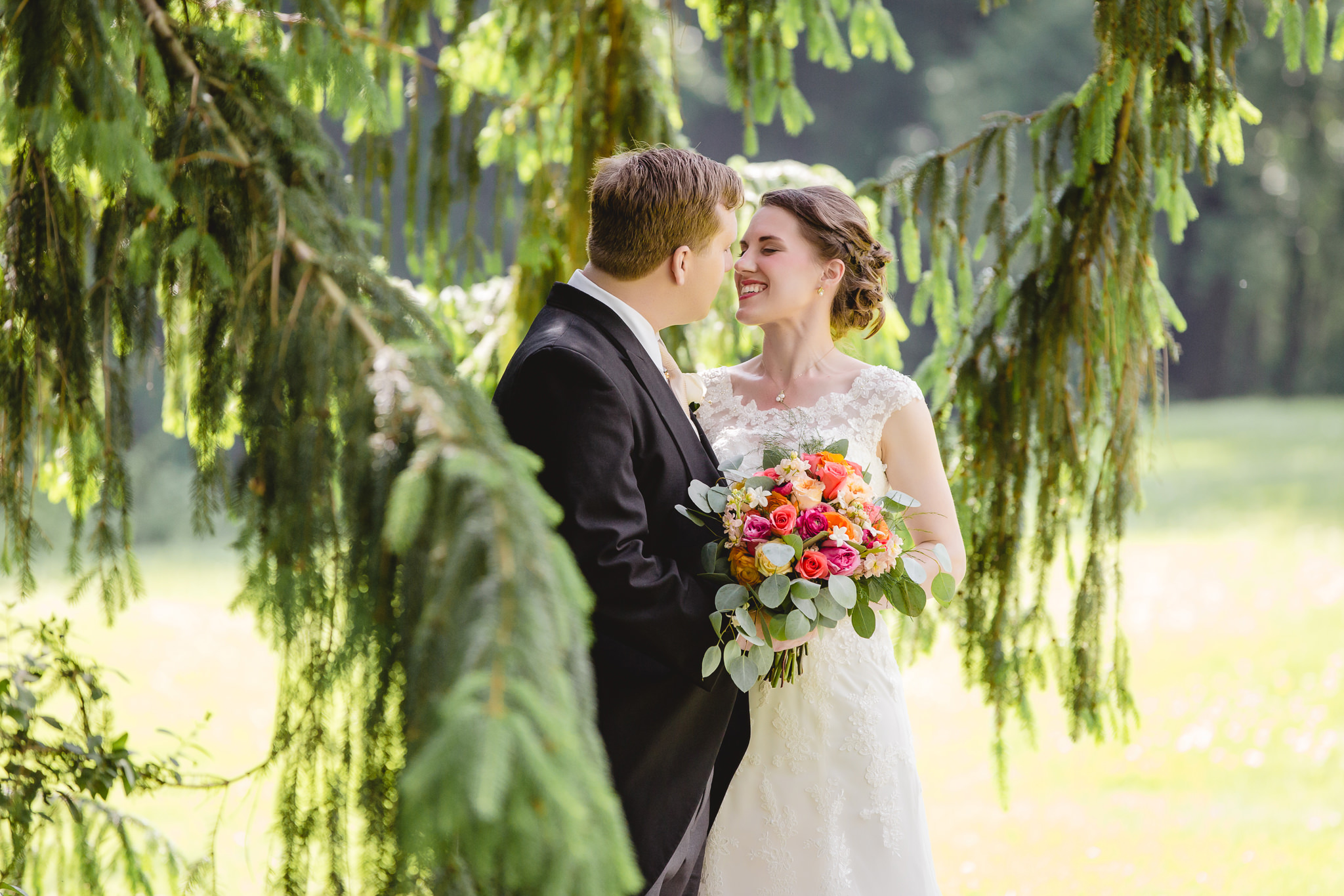 Bride & groom among pine trees at Shannopin Country Club