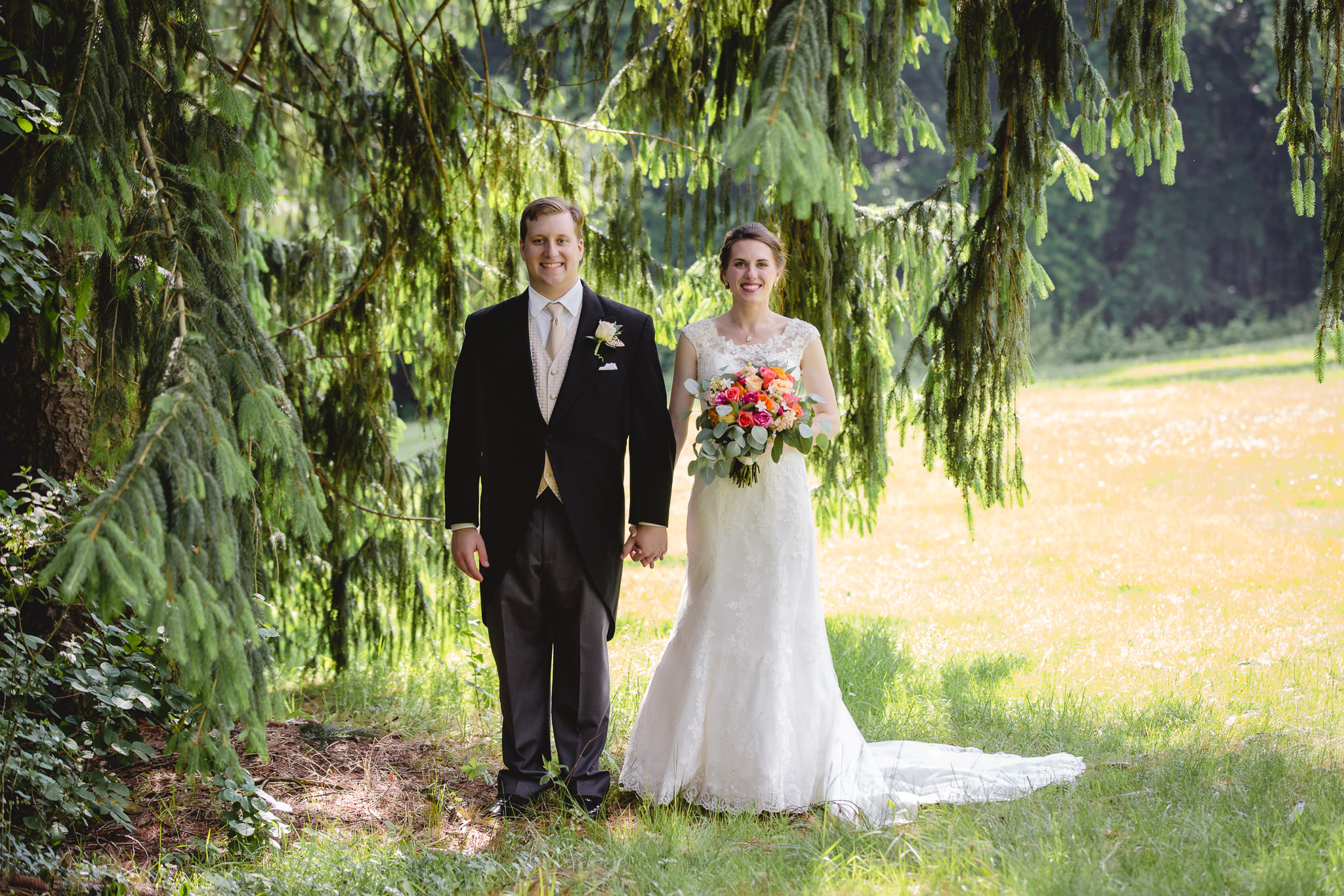 Bride & groom under pine tree at Shannopin Country Club