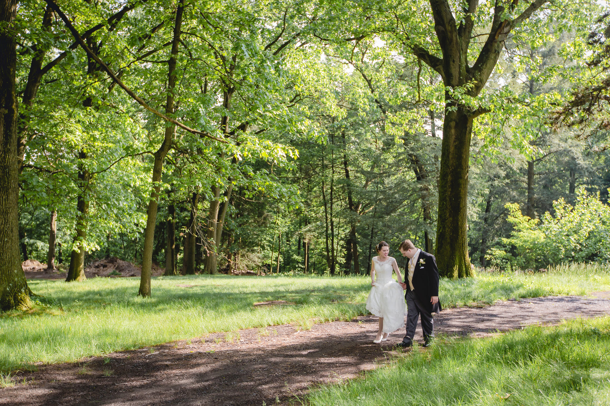 Bride walking with groom on a trail near Shannopin Country Club