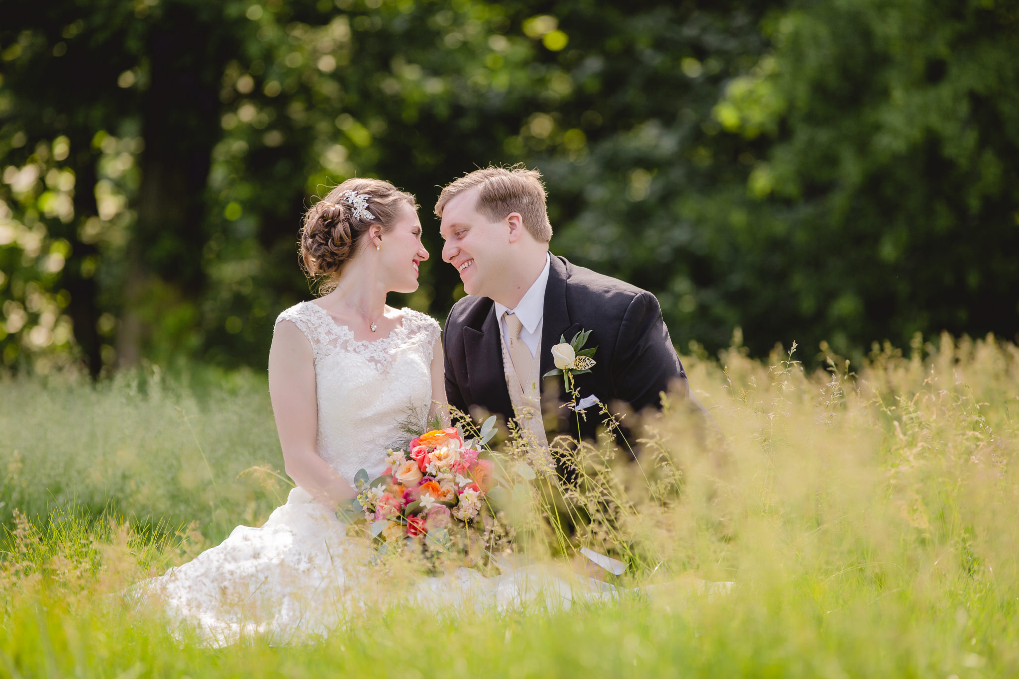 Bride & groom pose in field at Shannopin Country Club wedding