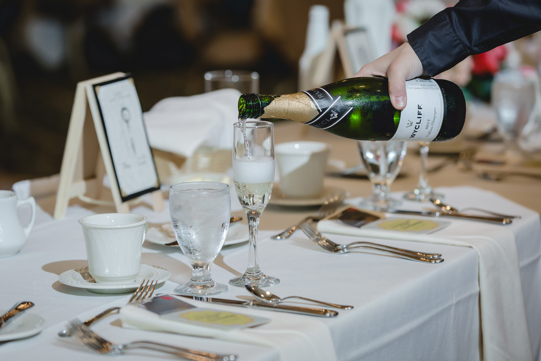 Champagne being poured at a wedding reception at Shannopin Country Club