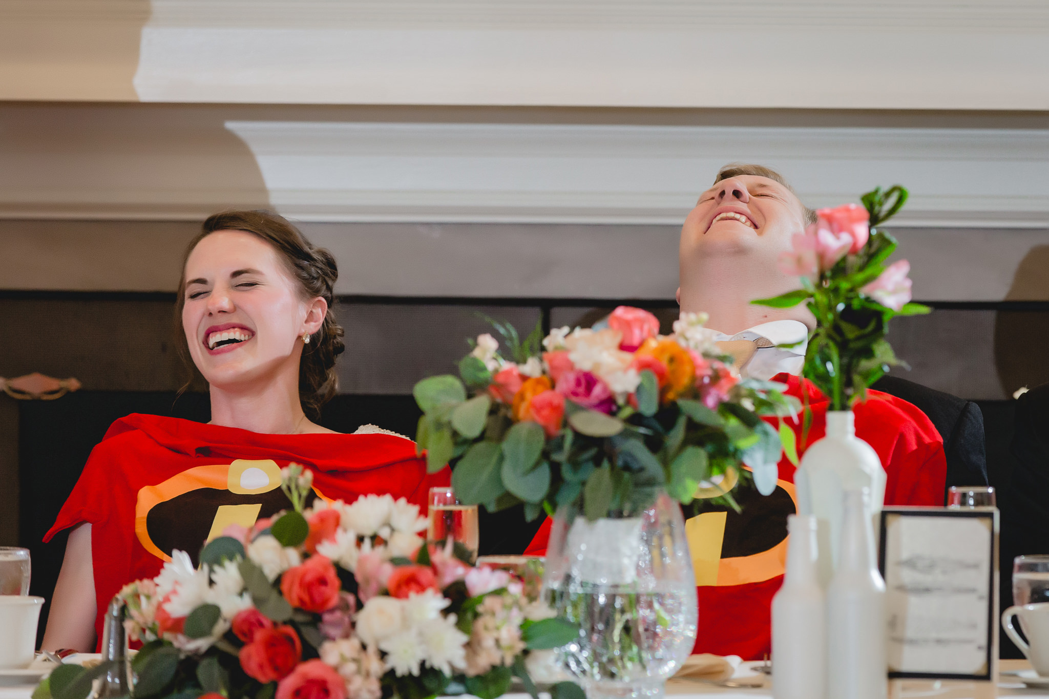 Bride & groom laughing at Incredibles t-shirt gifts at Shannopin Country Club
