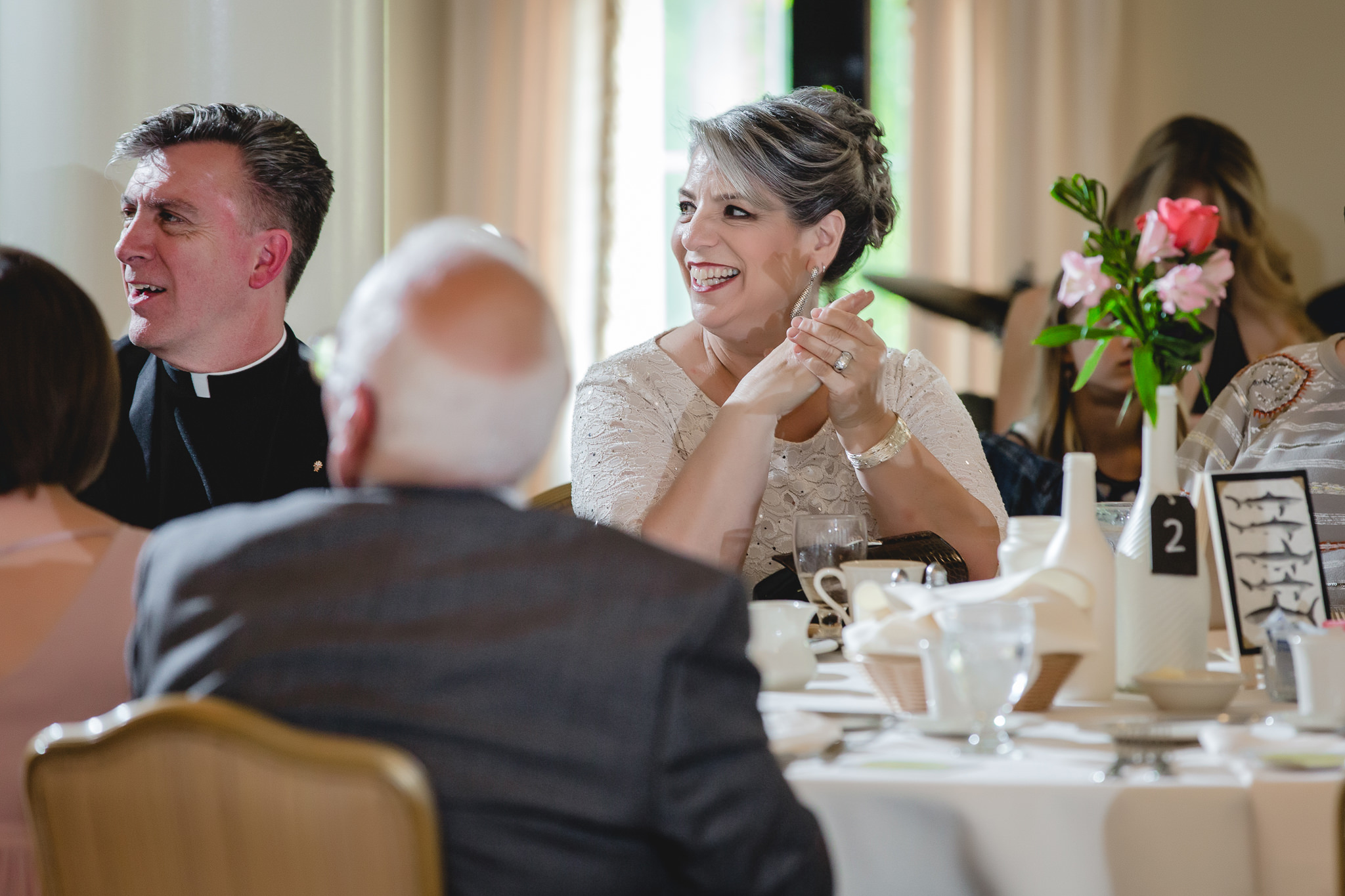 Mother of the groom laughs during best man's speech at Shannopin Country Club