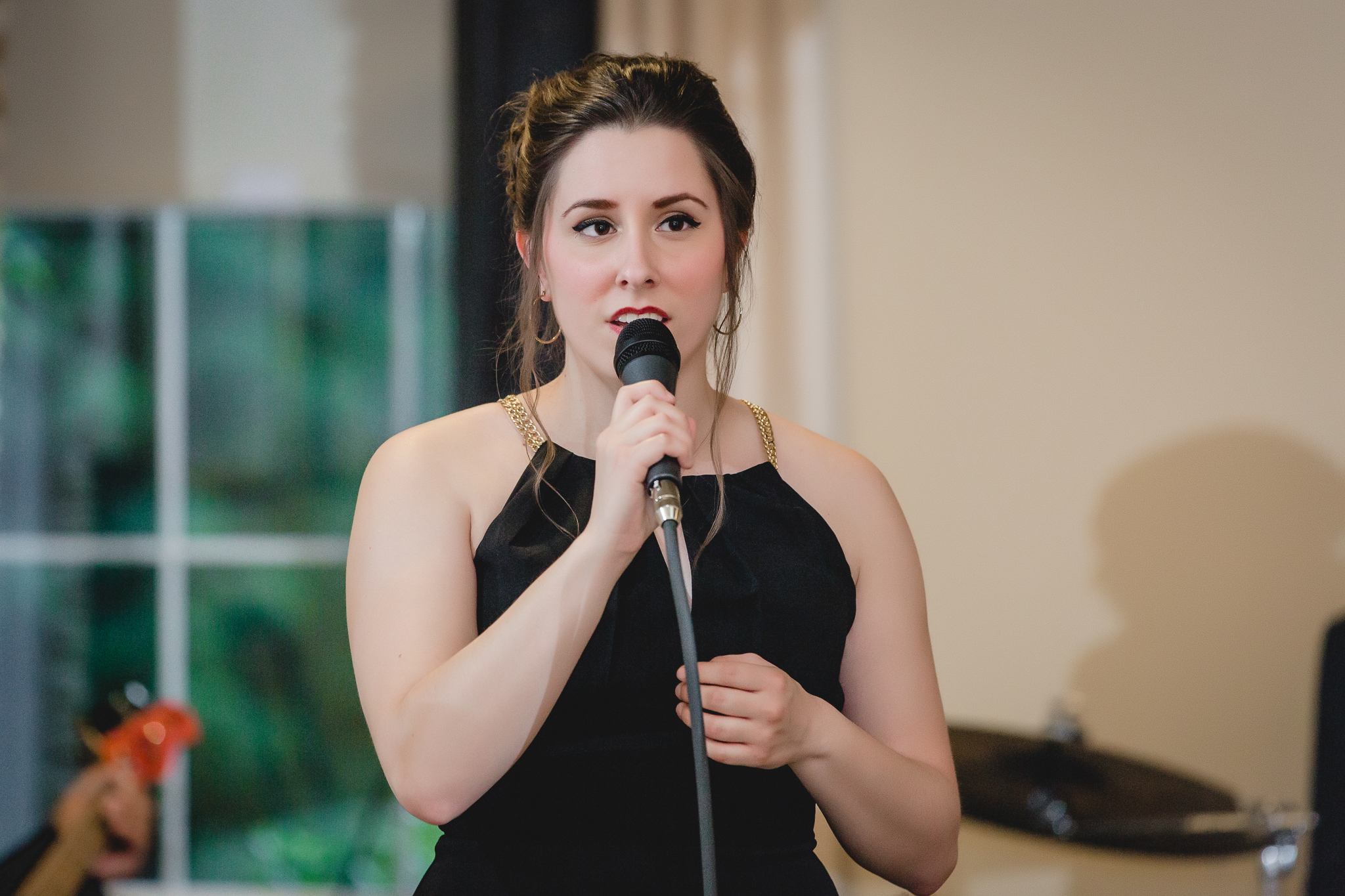 Soloist performs at wedding reception at Shannopin Country Club