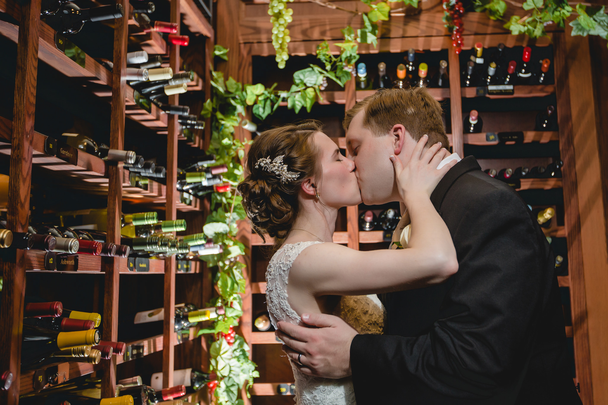 Bride & groom kiss in the wine cellar at Shannopin Country Club