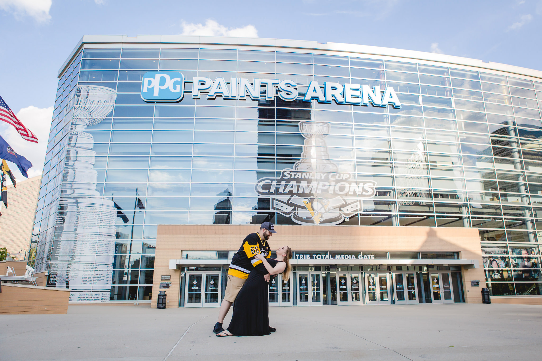 Pittsburgh Penguins fans pose in front of PPG Paints Arena during their Pittsburgh engagement session