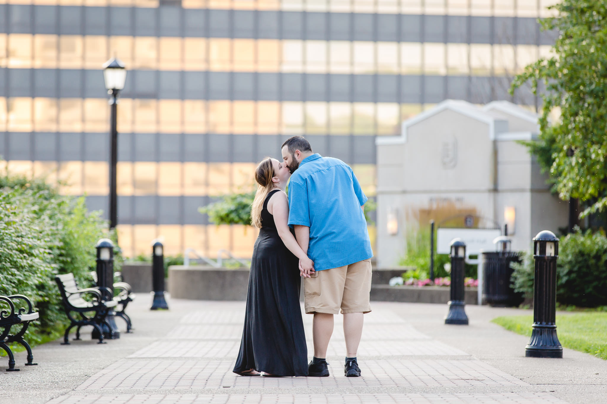 Couple pauses for a kiss near Rockwell Hall during their Duquesne University engagement session