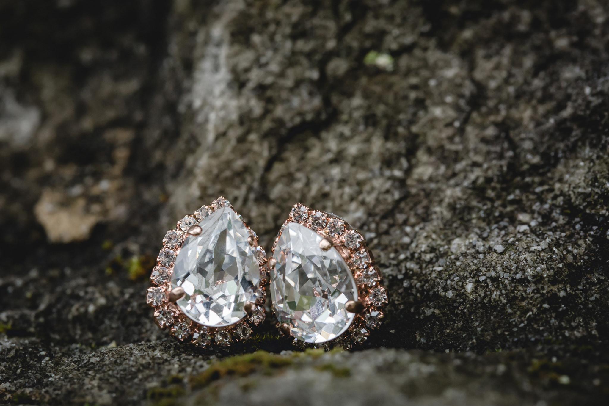 Pear-shaped diamond earrings on a rock at Hidden Valley Resort