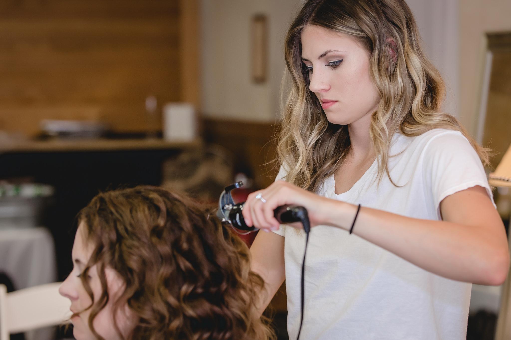 Bride curls her mother's hair at Hidden Valley Resort