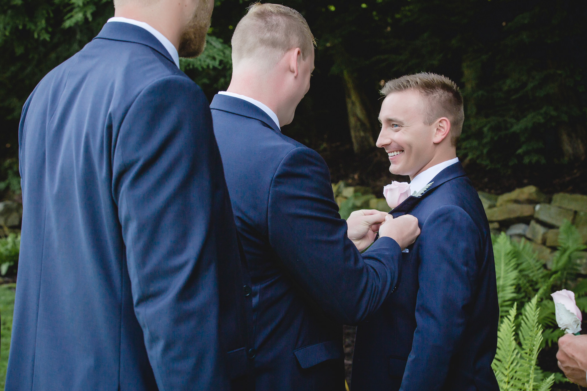 Groomsman pins on the groom's boutonniere at Hidden Valley Resort