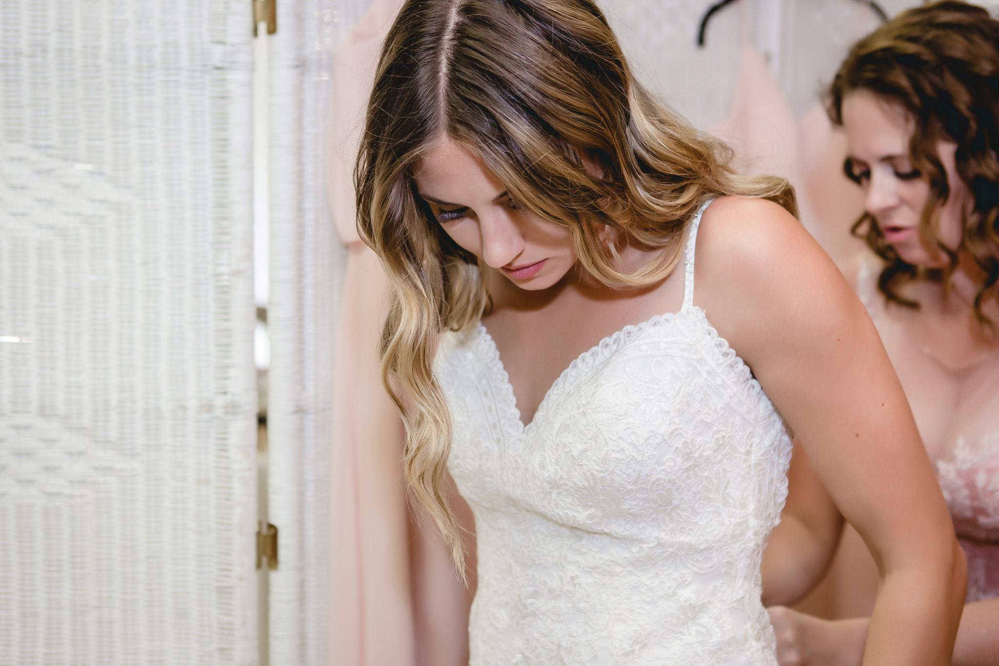 Mother of the bride zips up the bride's dress at Hidden Valley Resort