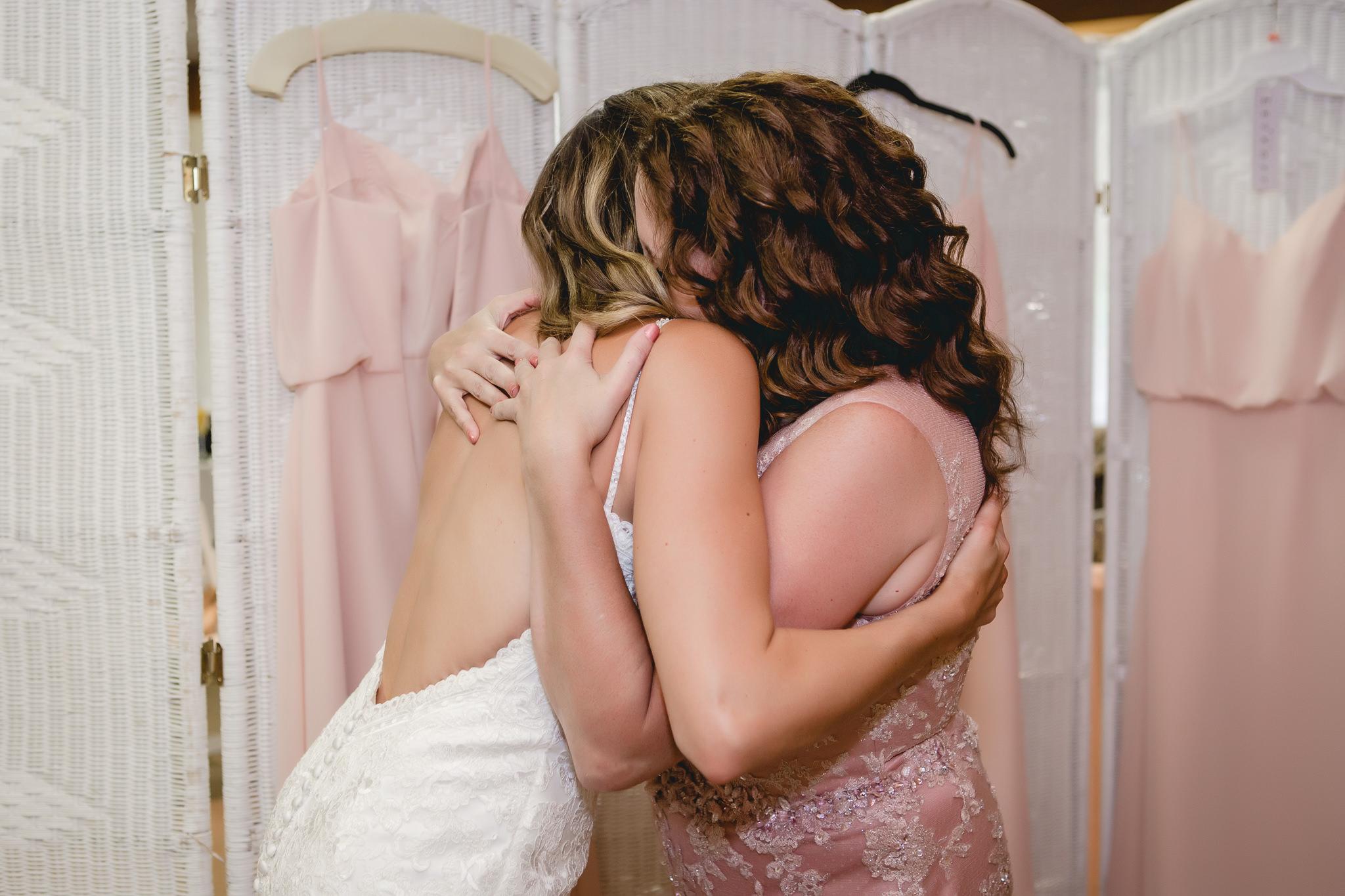 Mother of the bride hugs her daughter before her Hidden Valley Resort wedding ceremony