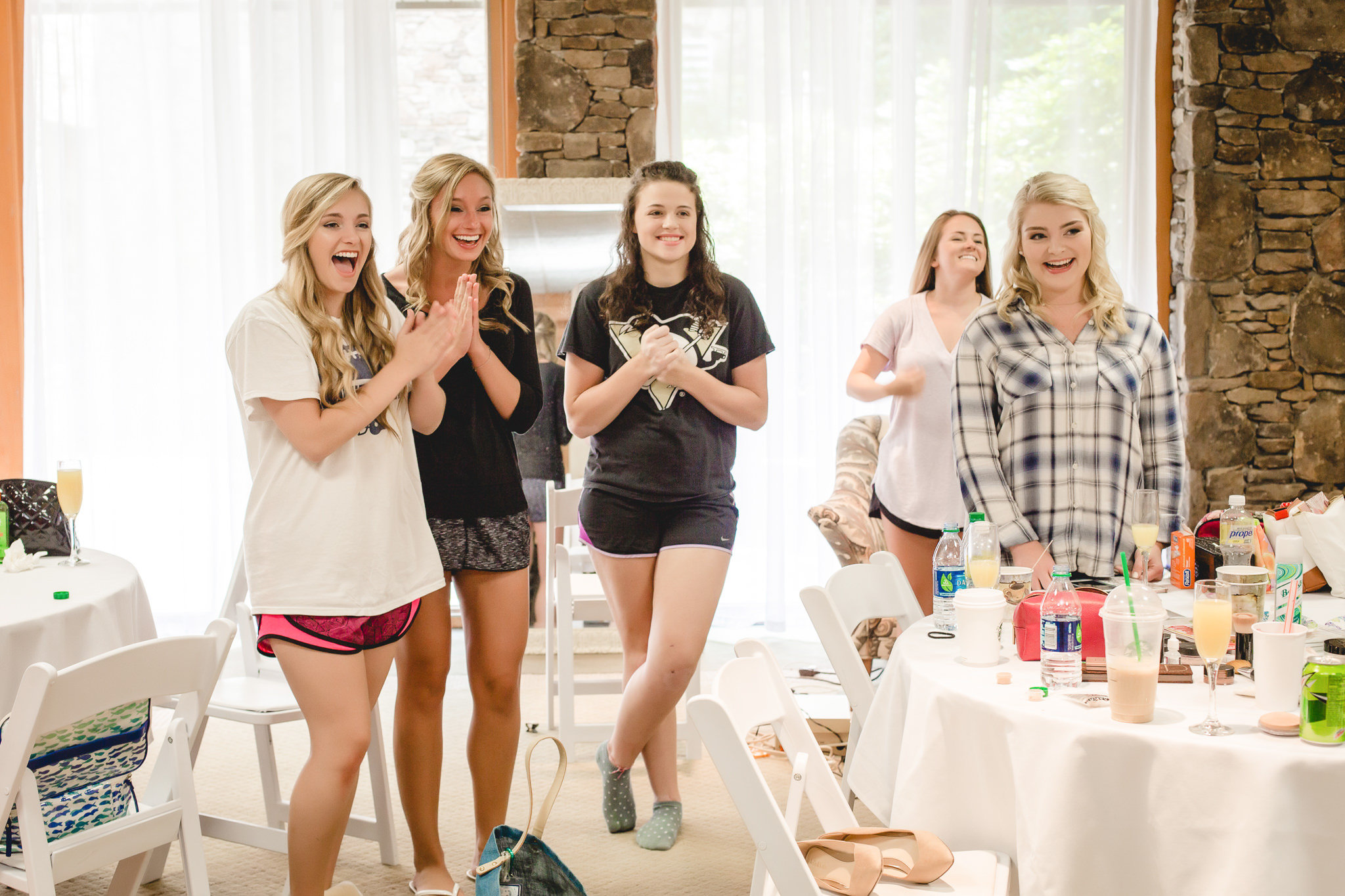 Bridesmaids react to seeing the bride in her dress