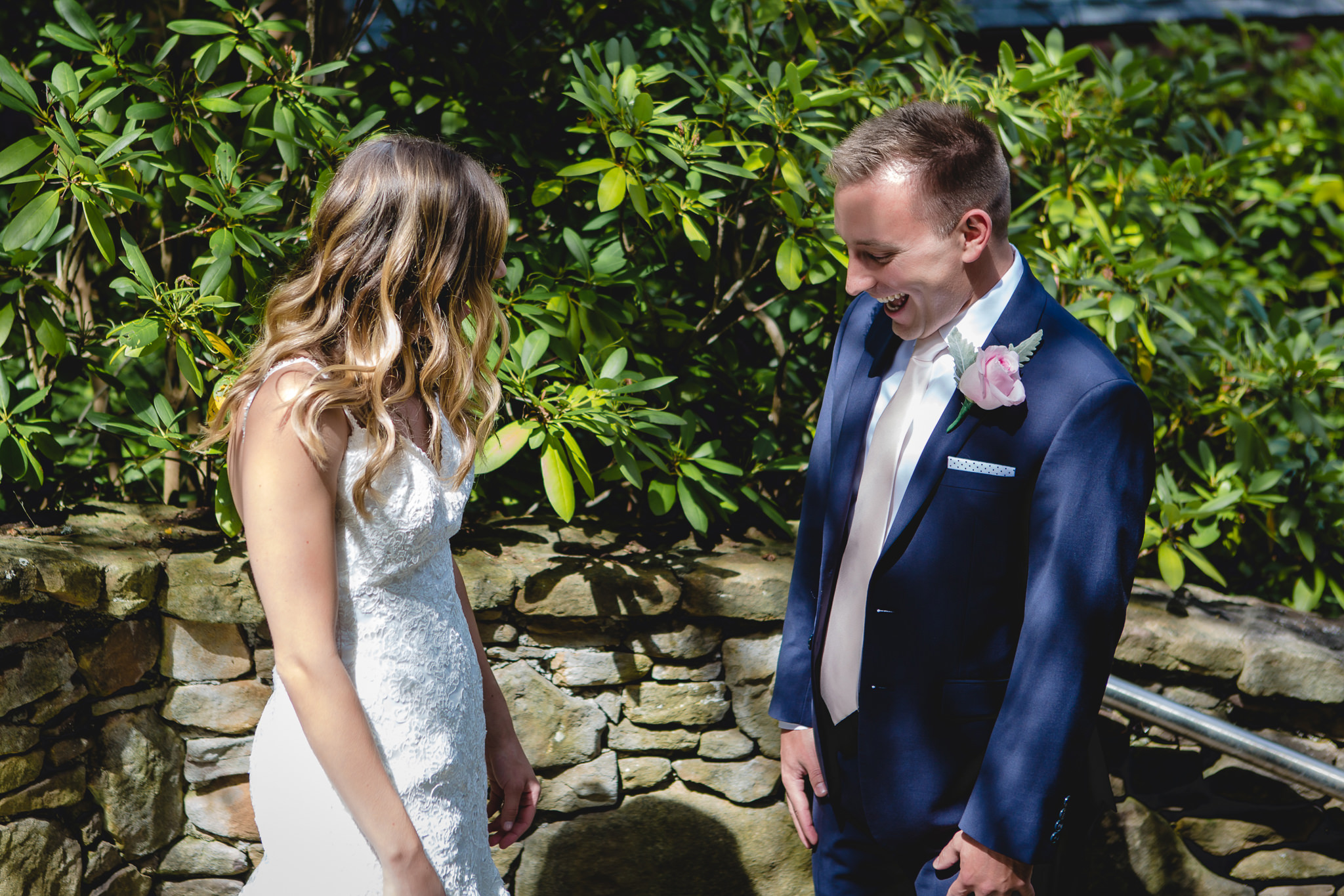 Groom reacts to seeing his bride in her dress for the first time