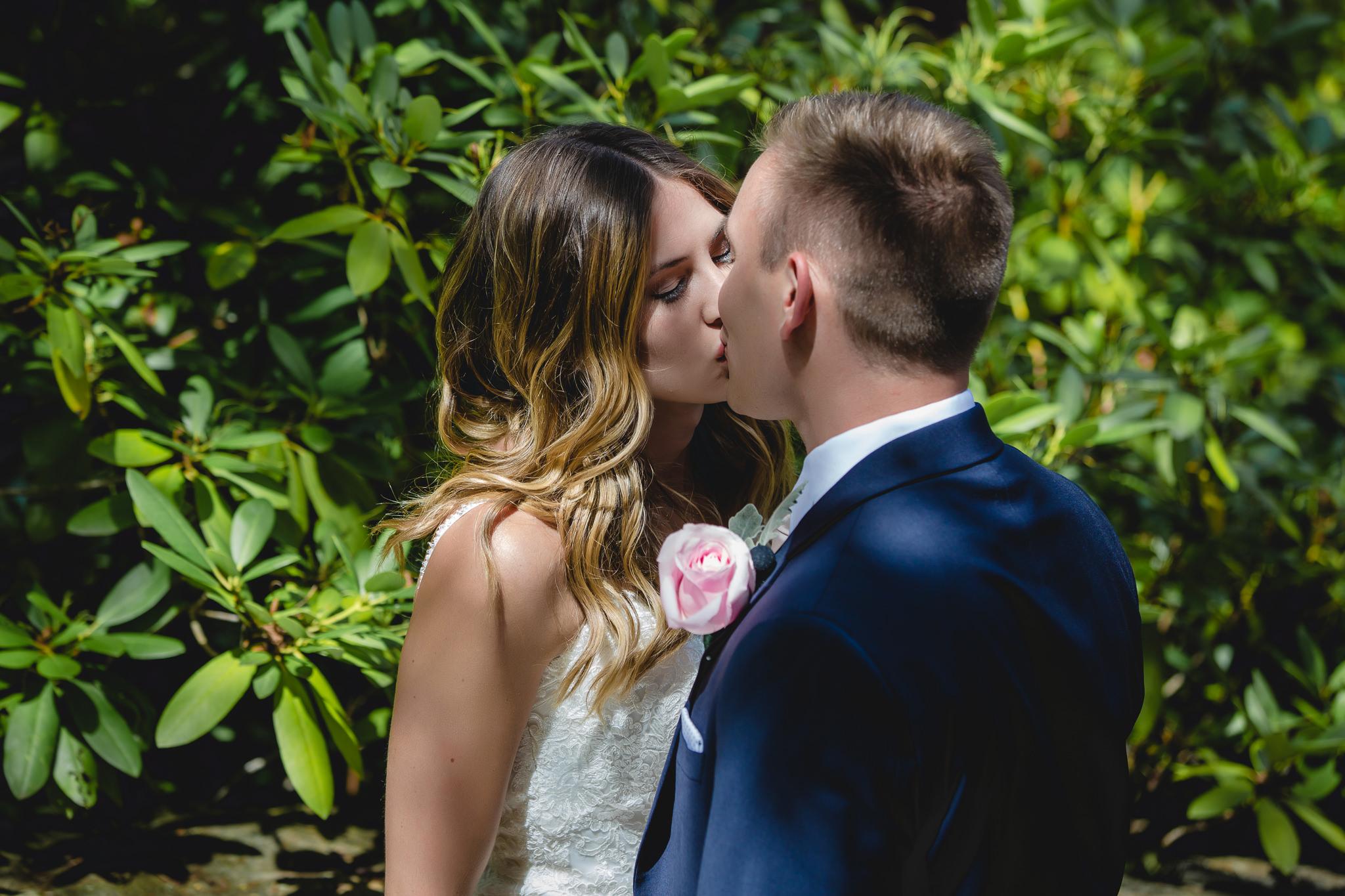Bride kisses her groom at Hidden Valley Resort