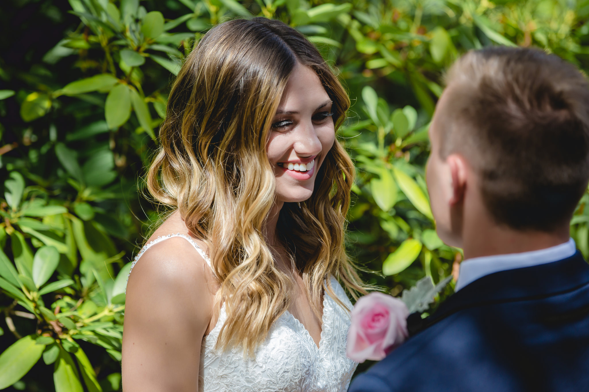 Bride and groom share a laugh before their wedding ceremony at Hidden Valley Resort