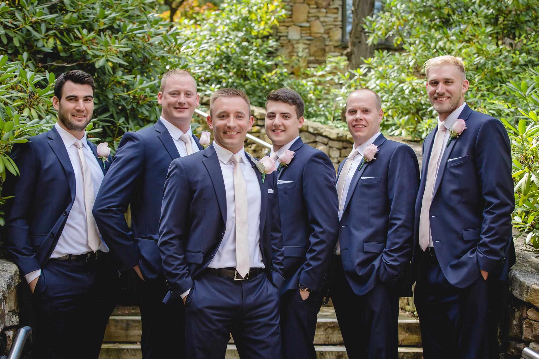 Groom poses with his groomsmen at Hidden Valley Resort