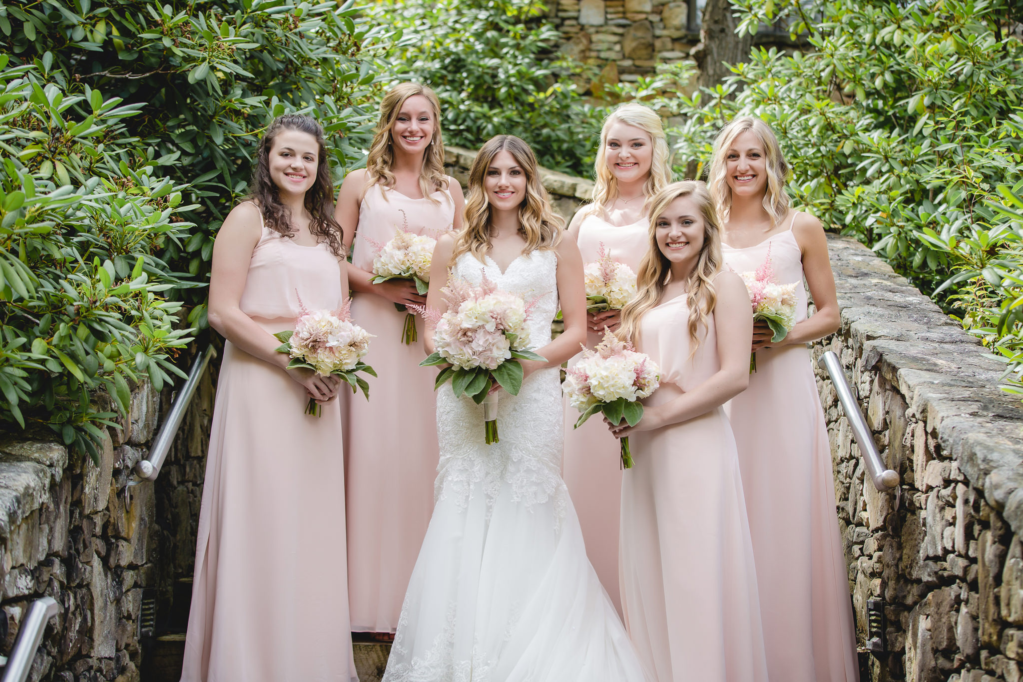 Bride poses with her bridesmaids at Hidden Valley Resort
