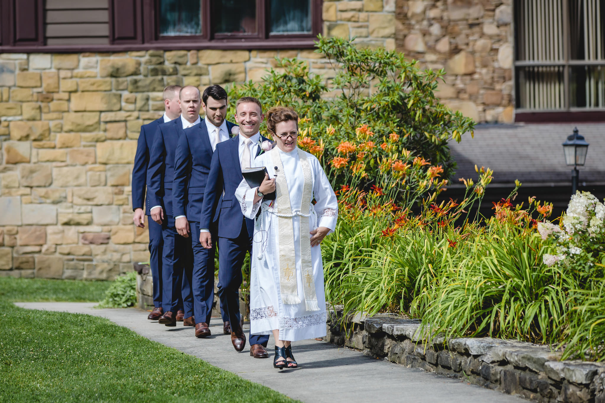 Groom and groomsmen approach the ceremony site at Hidden Valley Resort
