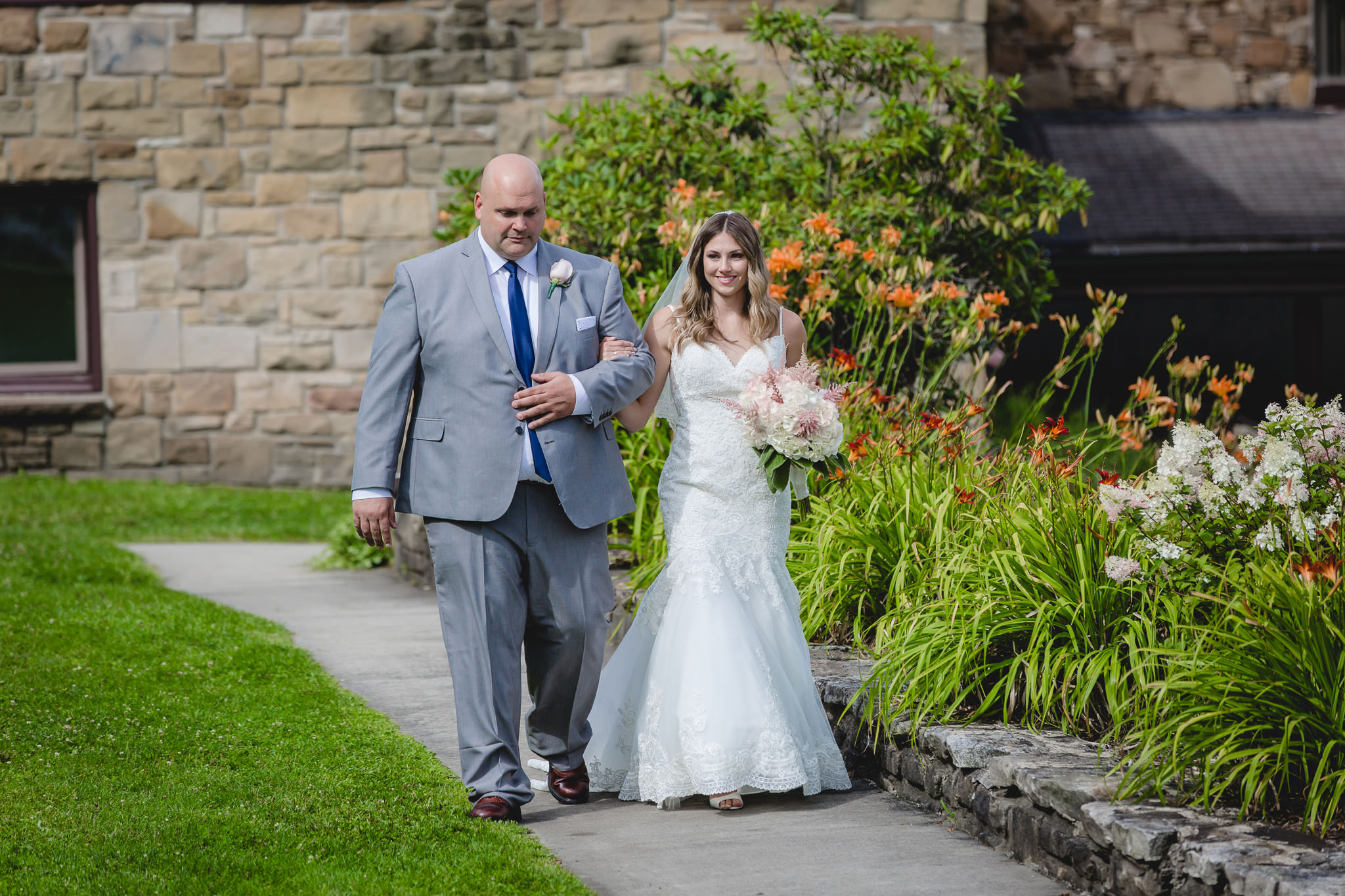 Father of the bride walks his daughter down the aisle at Hidden Valley Resort