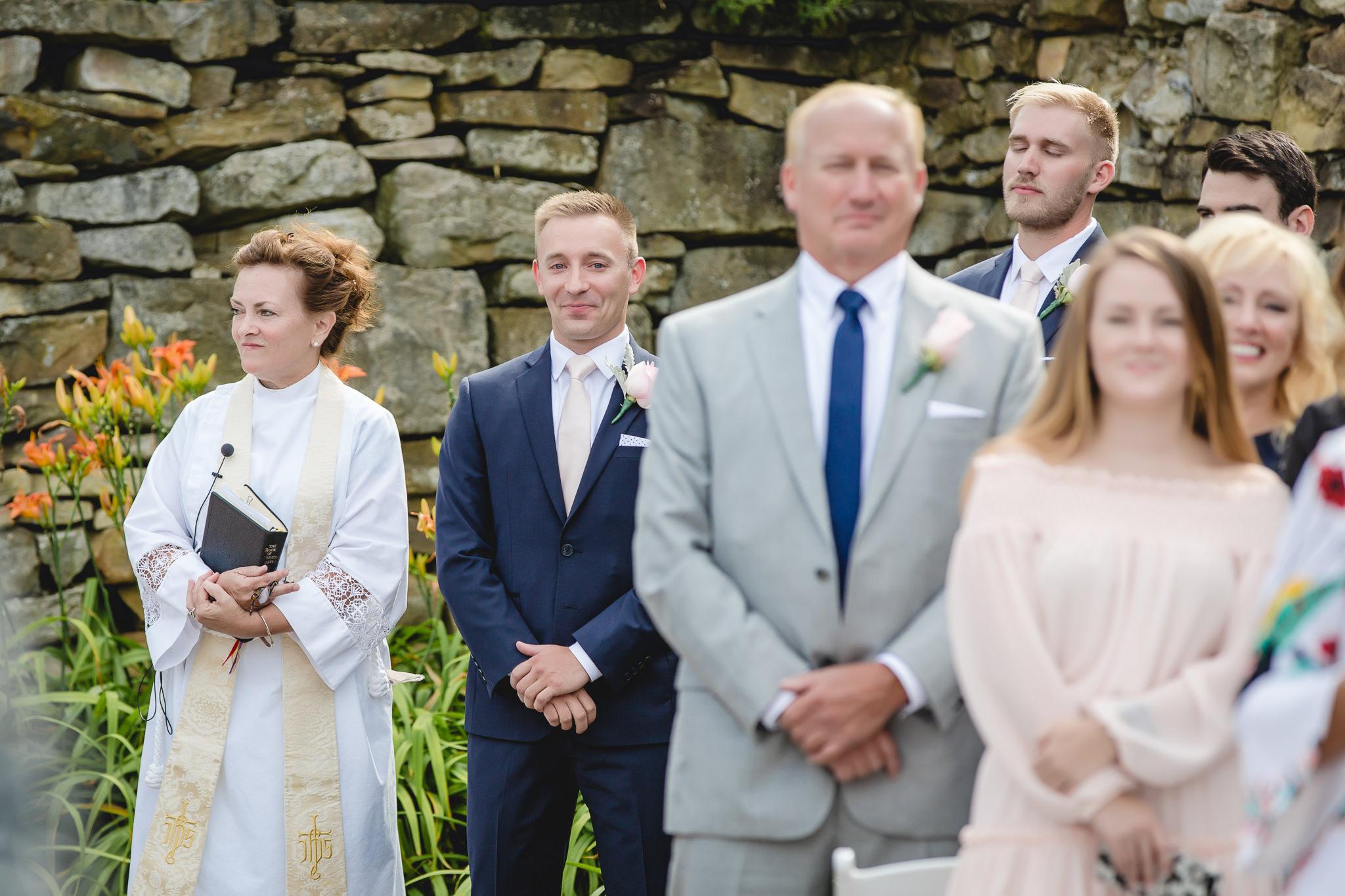 Groom gets emotional at his outdoor wedding ceremony at Hidden Valley Resort