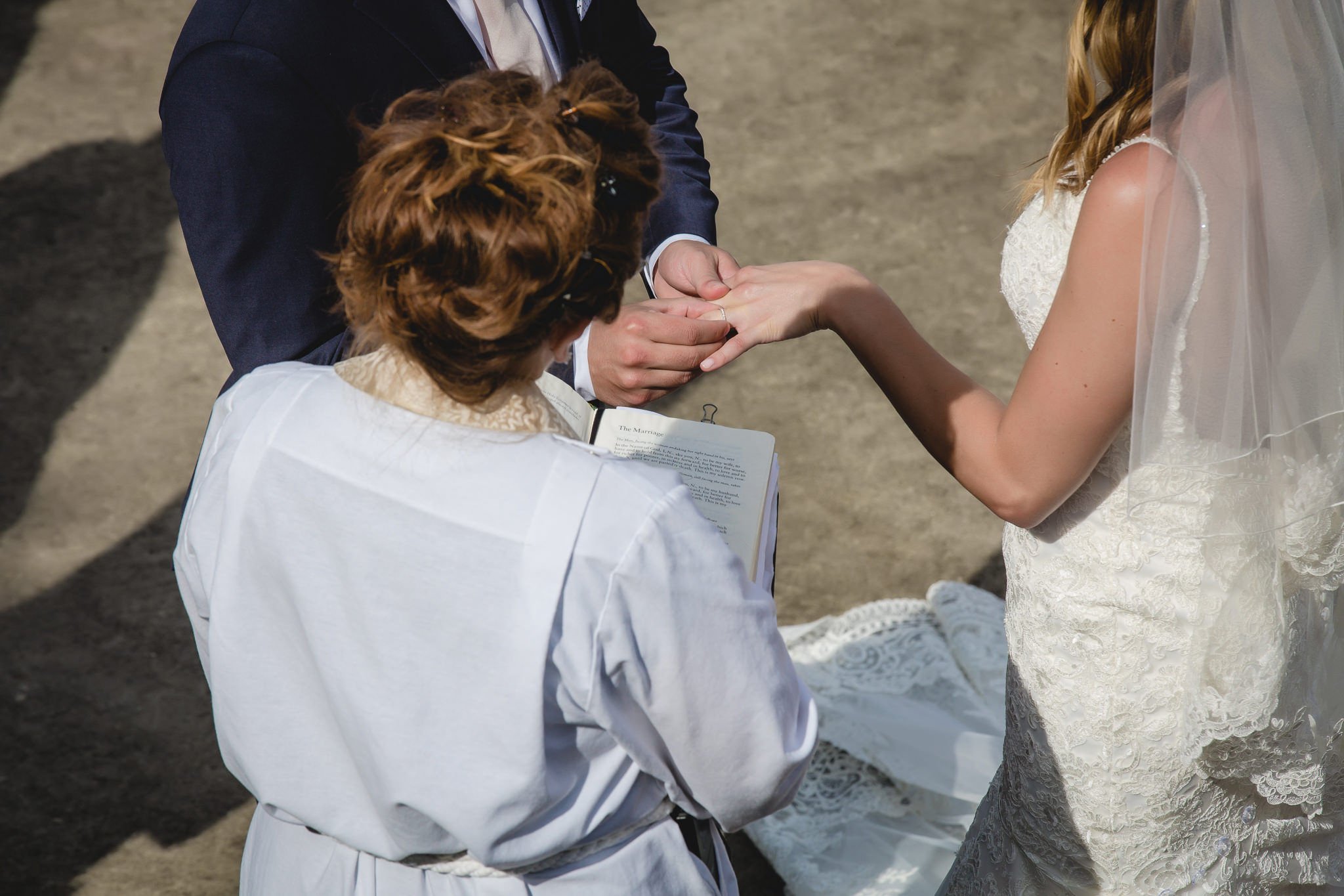 Groom places the ring on his bride's finger at Hidden Valley Resort