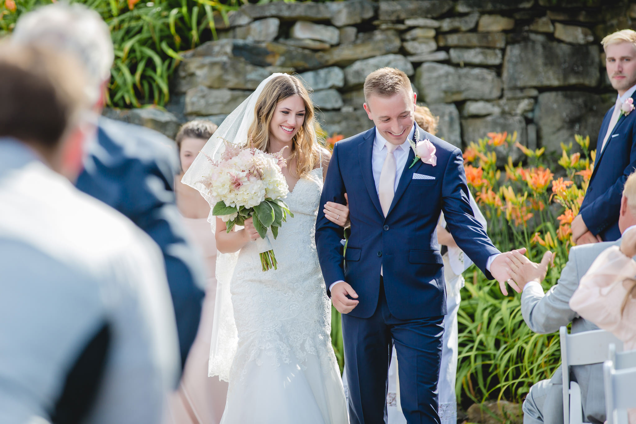 Groom high fives his father at his Hidden Valley Resort wedding ceremony